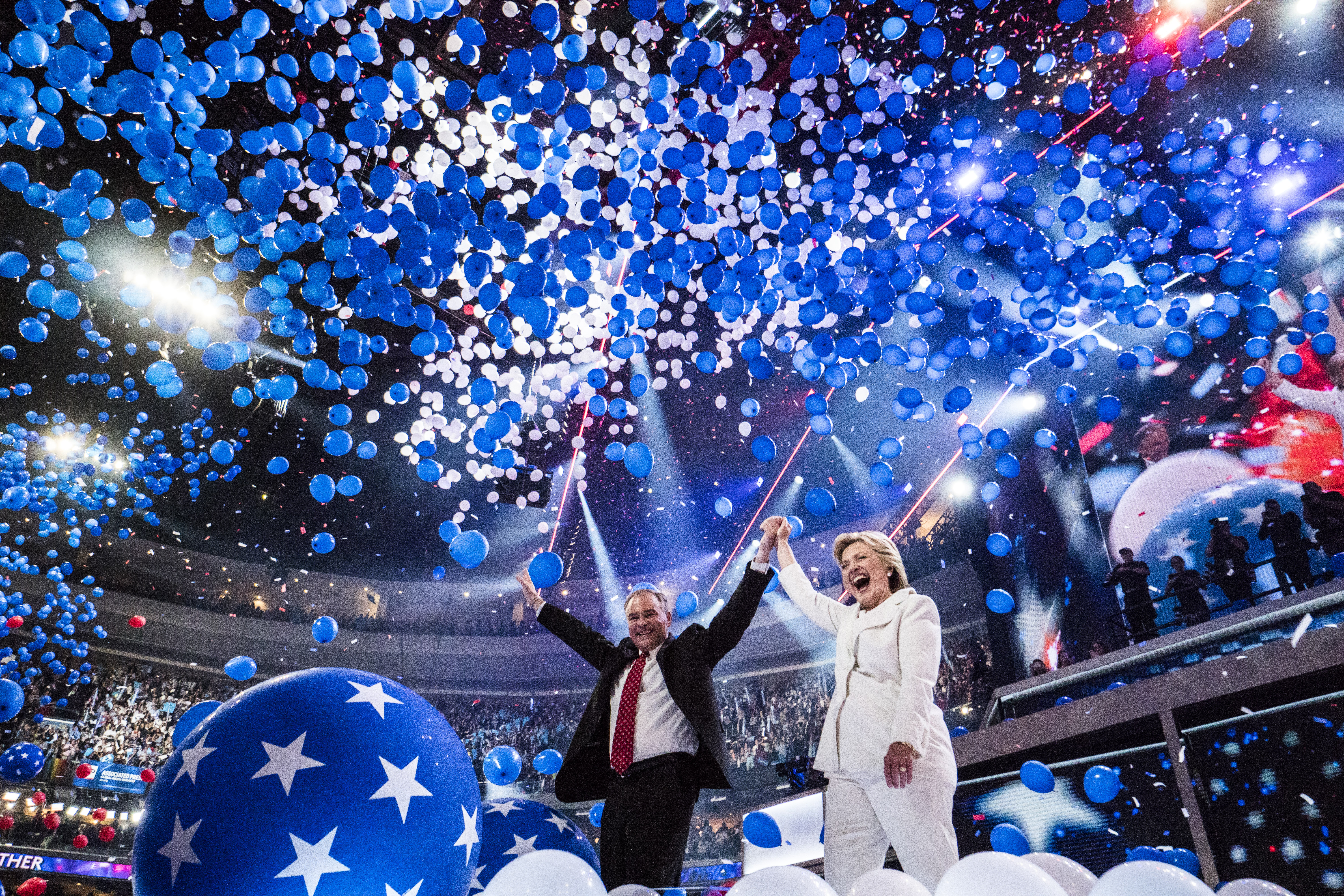 Democratic presidential nominee Hillary Clinton and running mate Tim Kaine celebrate at the Democratic National Convention in Philadelphia on July 28, 2016.