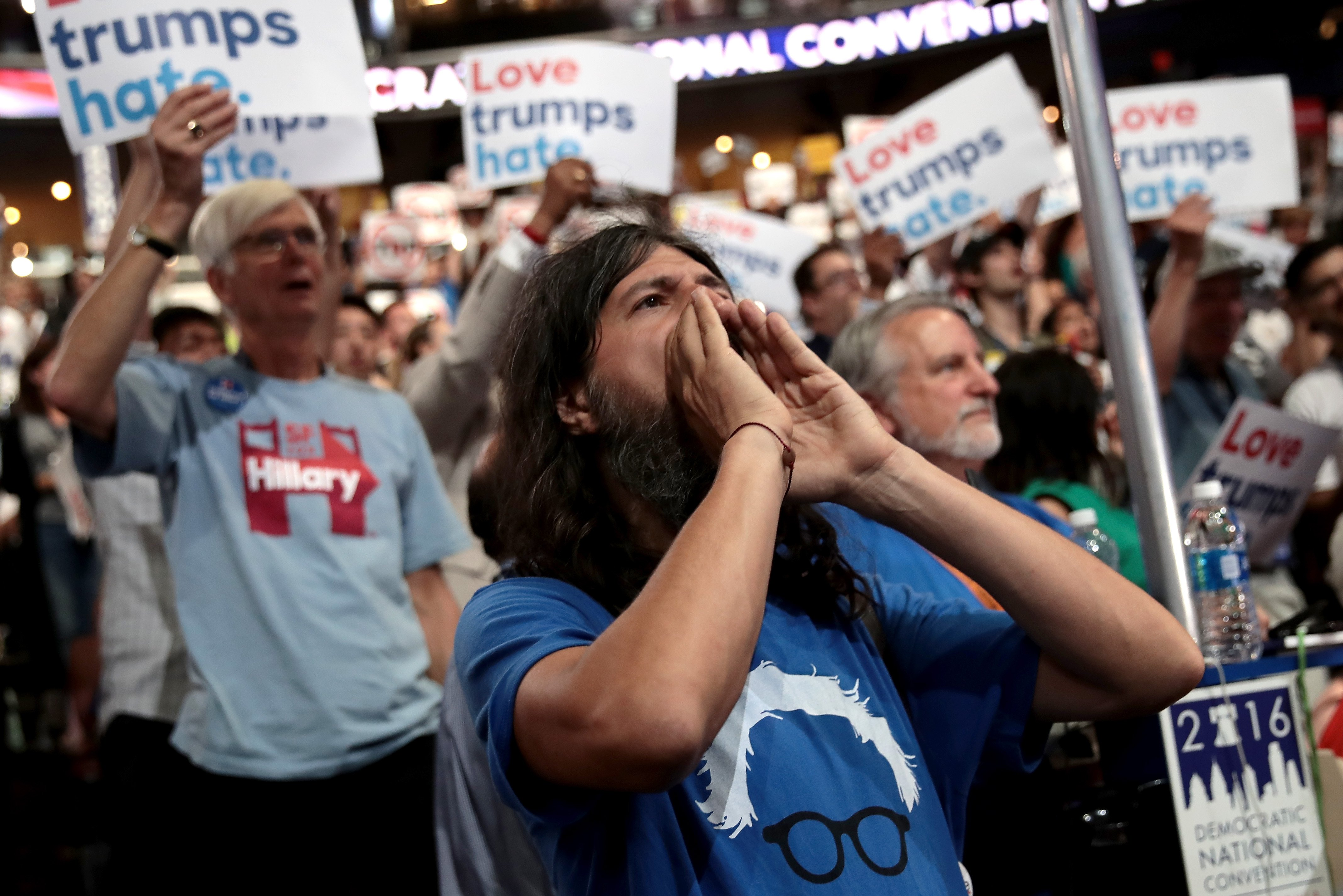 A supporter of Sen. Bernie Sanders (I-VT) chants on the first day of the Democratic National Convention at the Wells Fargo Center.