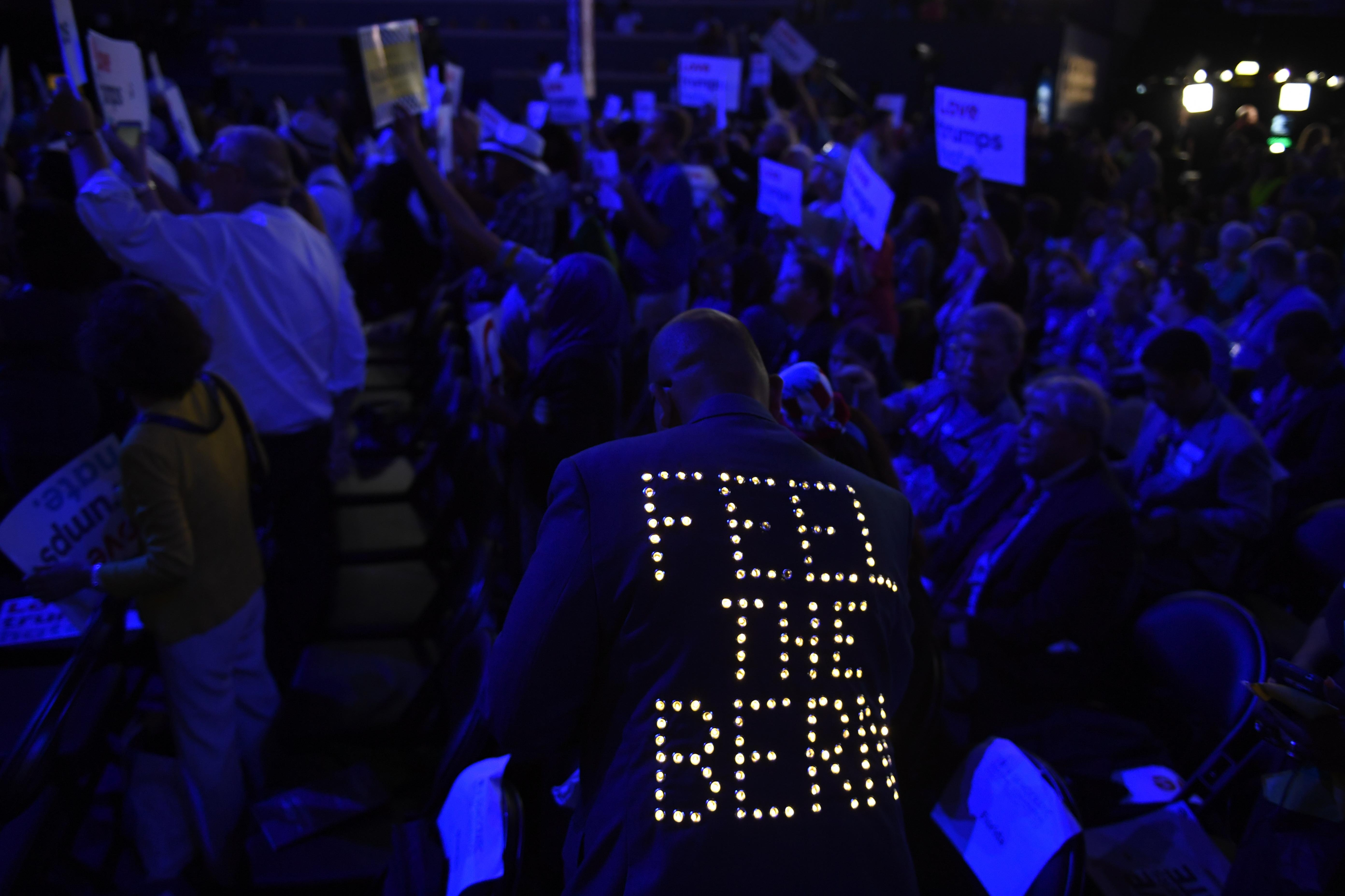 A supporter of Bernie Sanders wears a sequined jacket during the 2016 Democratic National Convention at Wells Fargo Arena.