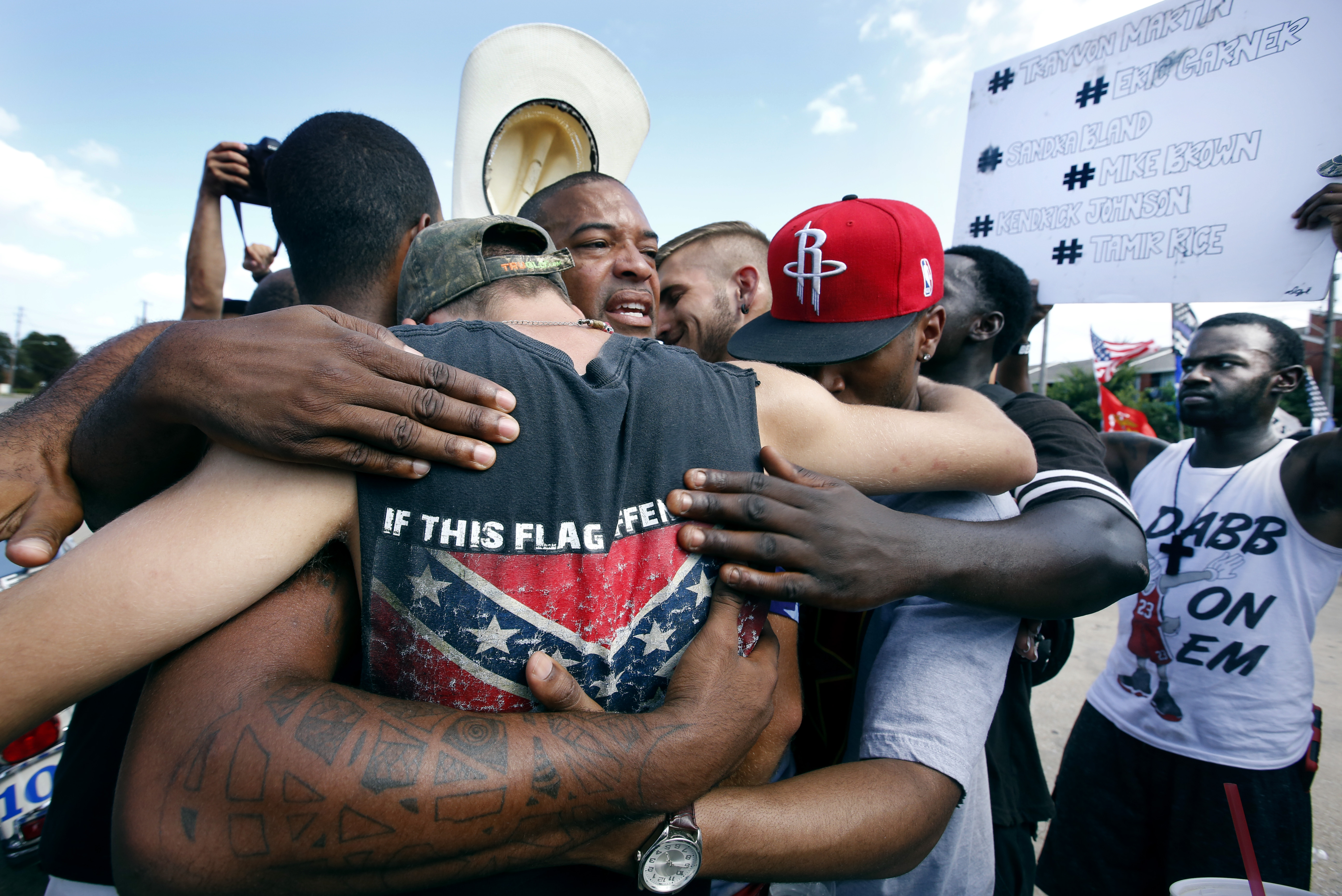 All Lives Matter protesters come together for a group hug with join Black Lives Matter activists in Dallas at Park Ln & Fair Oaks Ave. July 10th.