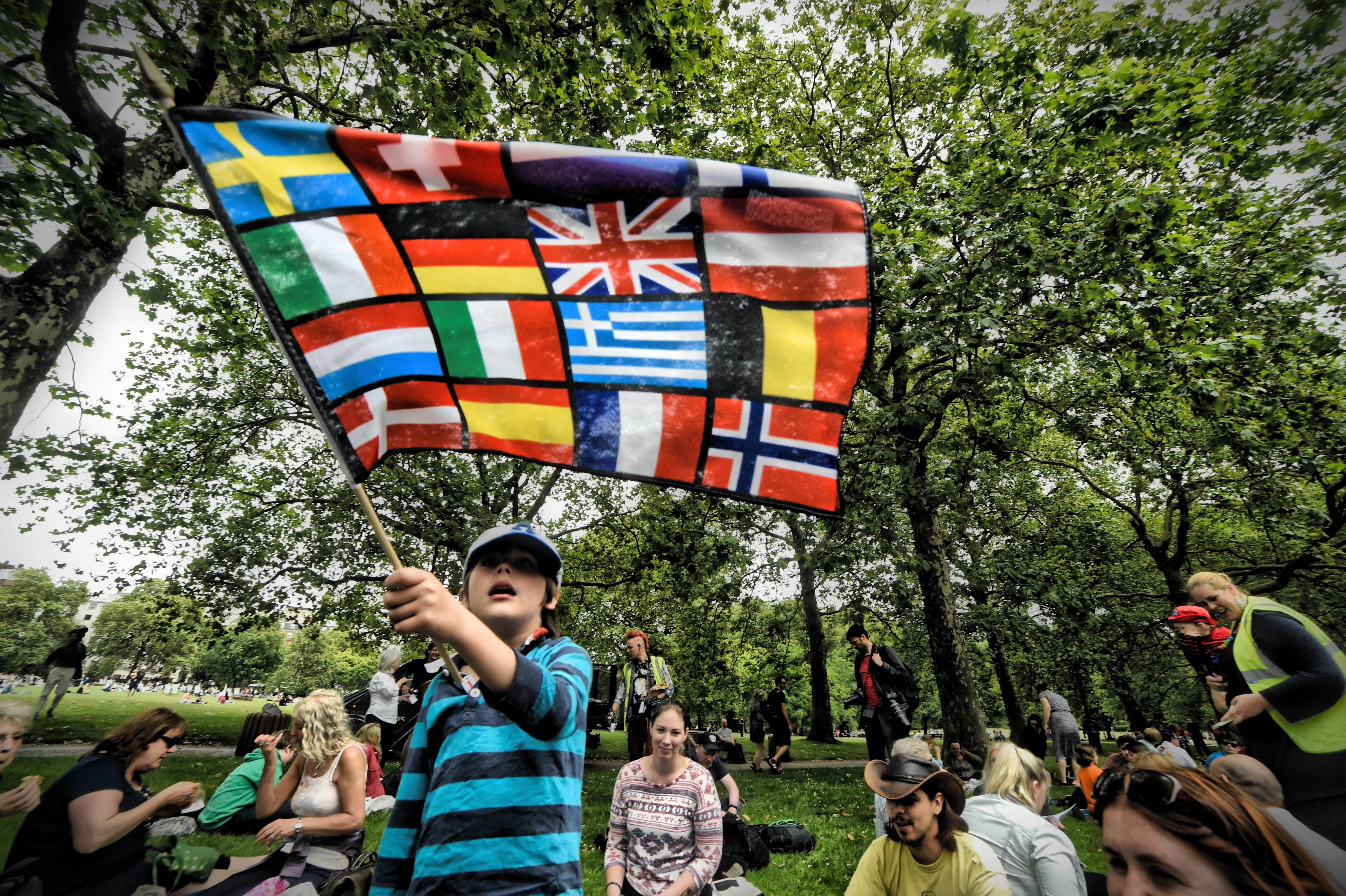 Pro-European Union supporters and pro-Brexit supporters hold up placards during a demonstration against Brexit in Green Park in London on July 9, 2016.