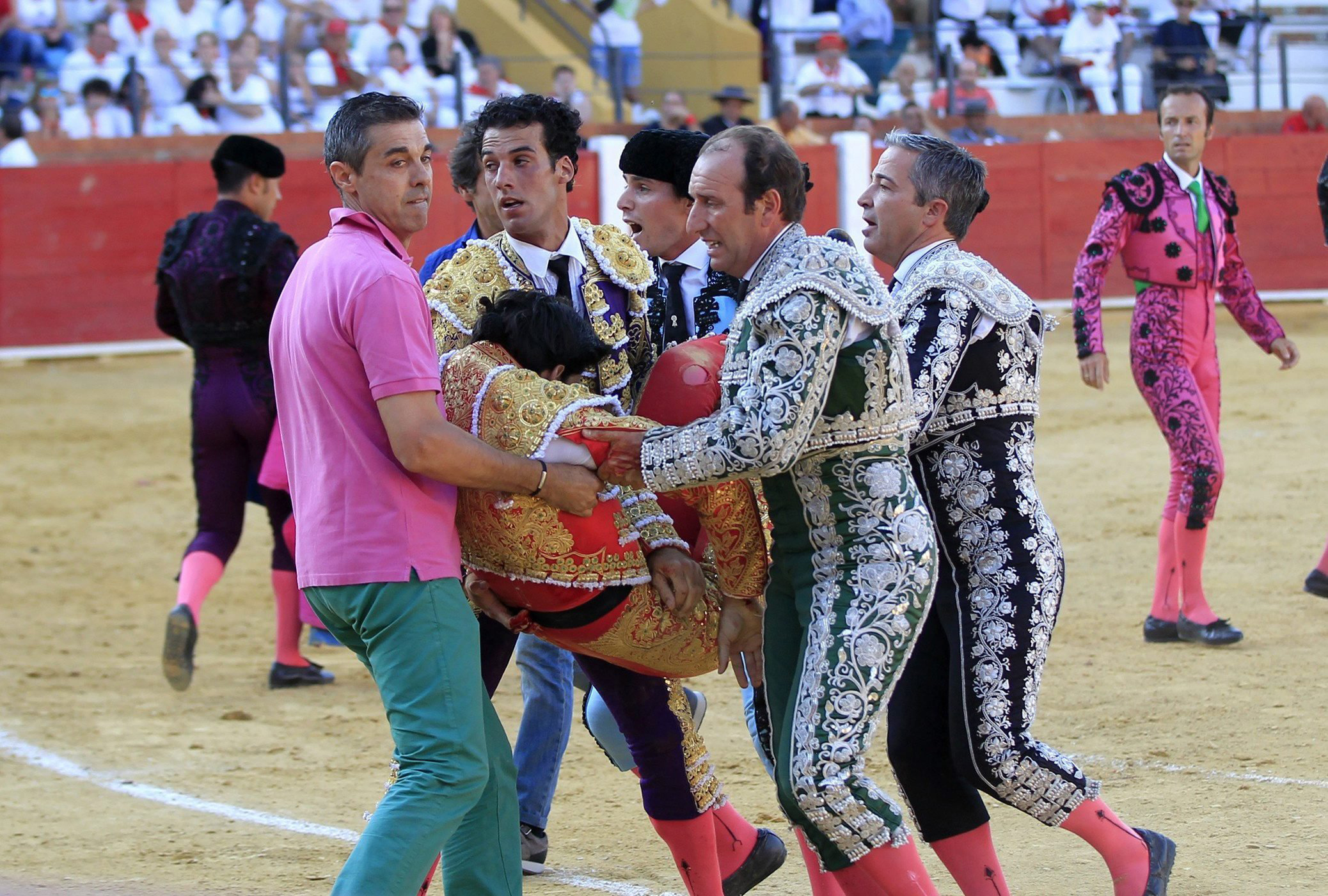Spanish bullfighter Victor Barrio, 29, is carried out from the bullring after being gored during a bullfight held on the occasion of Feria del Angel in Teruel, Aragon, July 9, 2016.