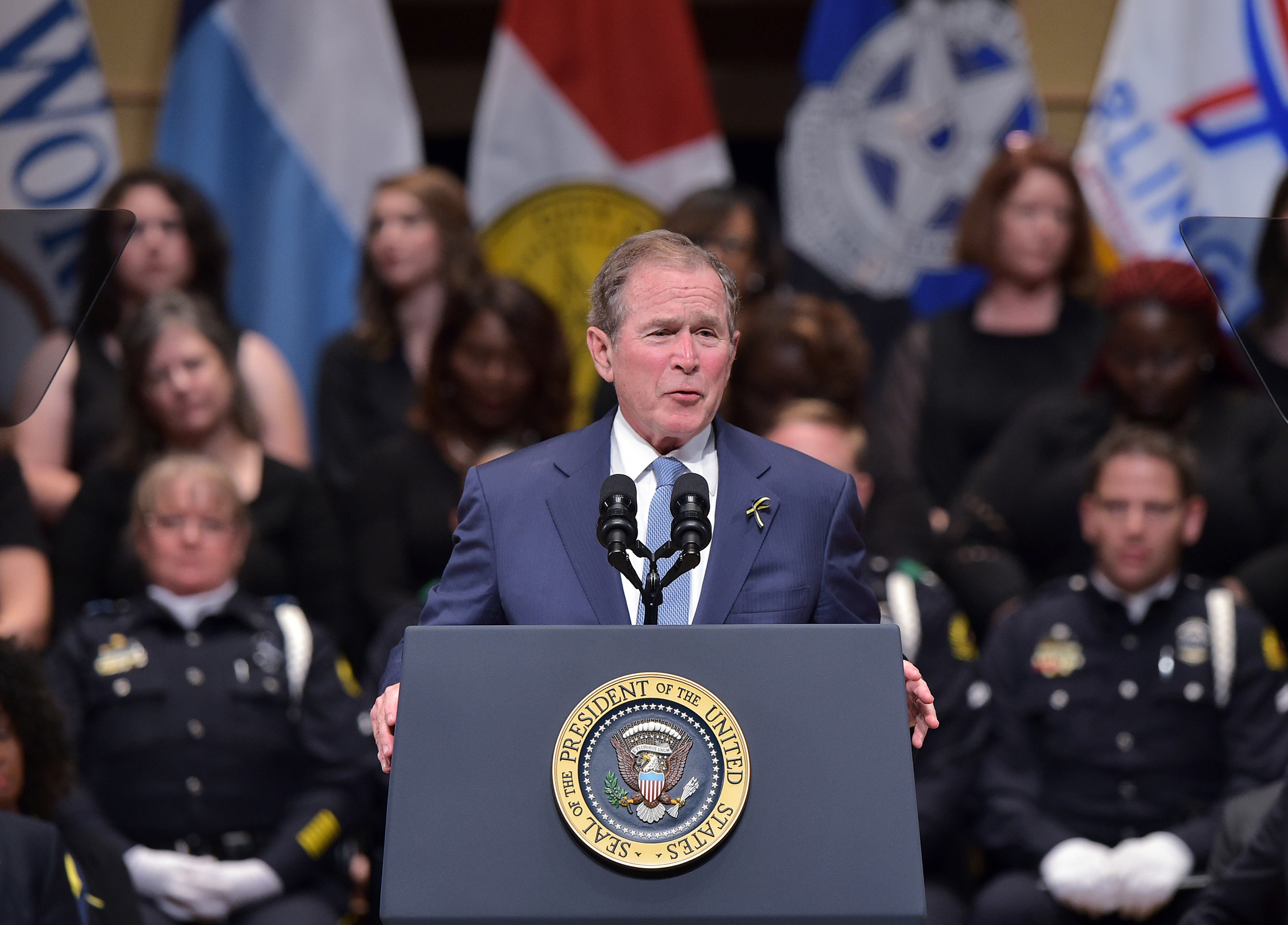George W. Bush speaks during an interfaith memorial service for the victims of the Dallas police shooting at the Morton H. Meyerson Symphony Center in Dallas, Texas, on July 12, 2016.
