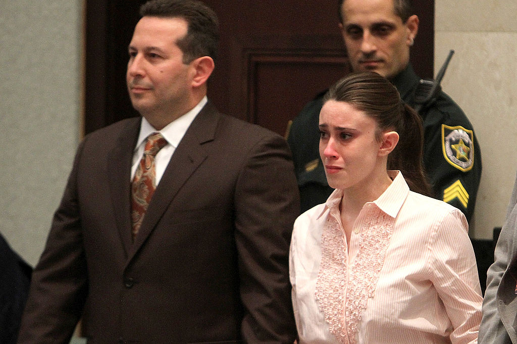 Casey Anthony (R) reacts to being found not guilty on murder charges at the Orange County Courthouse on July 5, 2011 in Orlando, Florida.