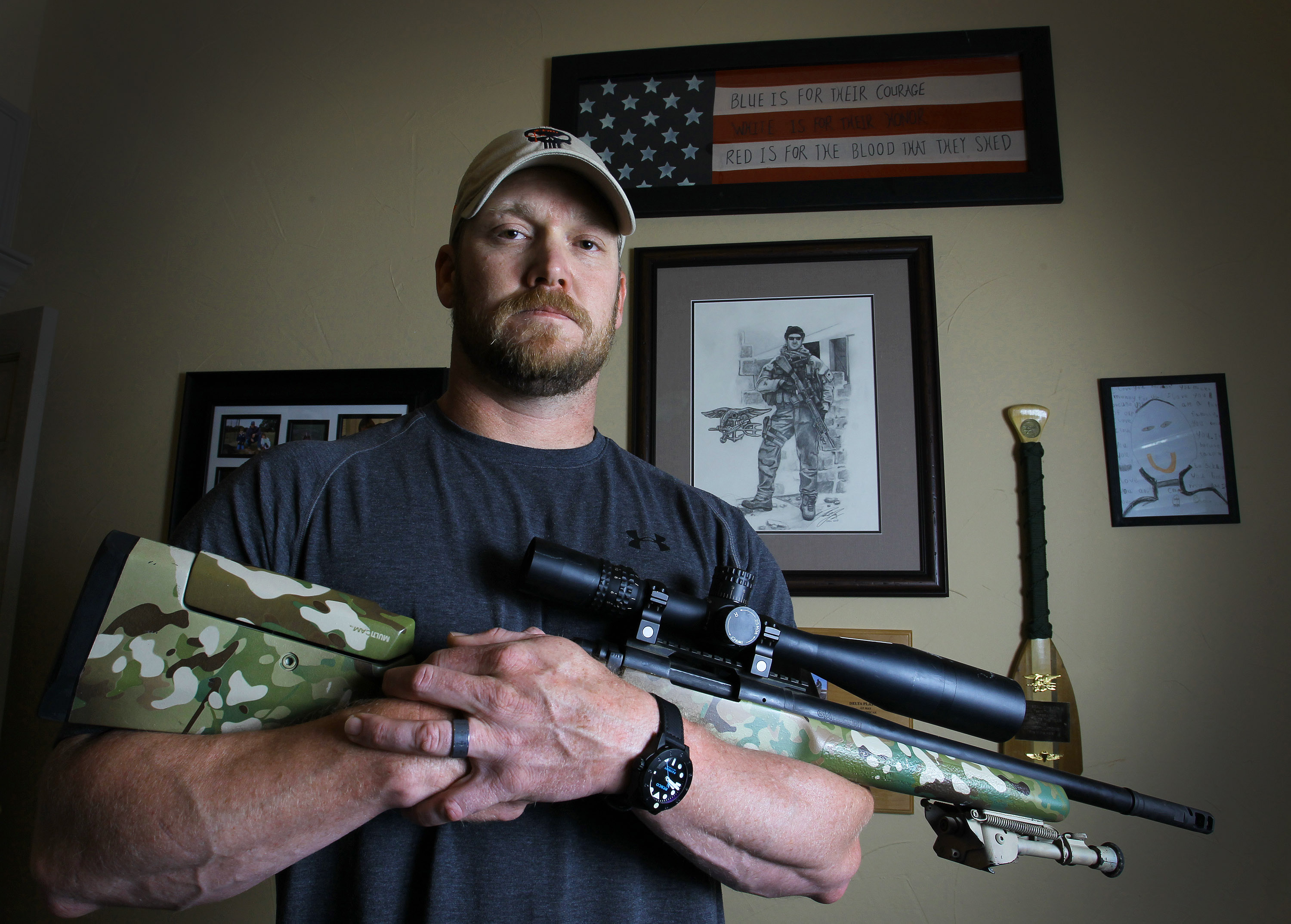 Chris Kyle, a retired Navy SEAL and bestselling author of the book  American Sniper: The Autobiography of the Most Lethal Sniper in U.S. Military History , holds a .308 sniper rifle in this April 6, 2012 photo.