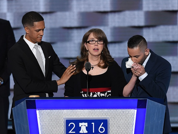 Christine Leinonen (C), mother of Christopher  Drew  Leinonen killed in the Pulse nightclub attack in Orlando, Florida, is joined by Brandon Wolf (L) and Jose Arriagada who survived the attack during the Democratic National Convention at the Wells Fargo Center in Philadelphia, Pennsylvania, July 27, 2016.