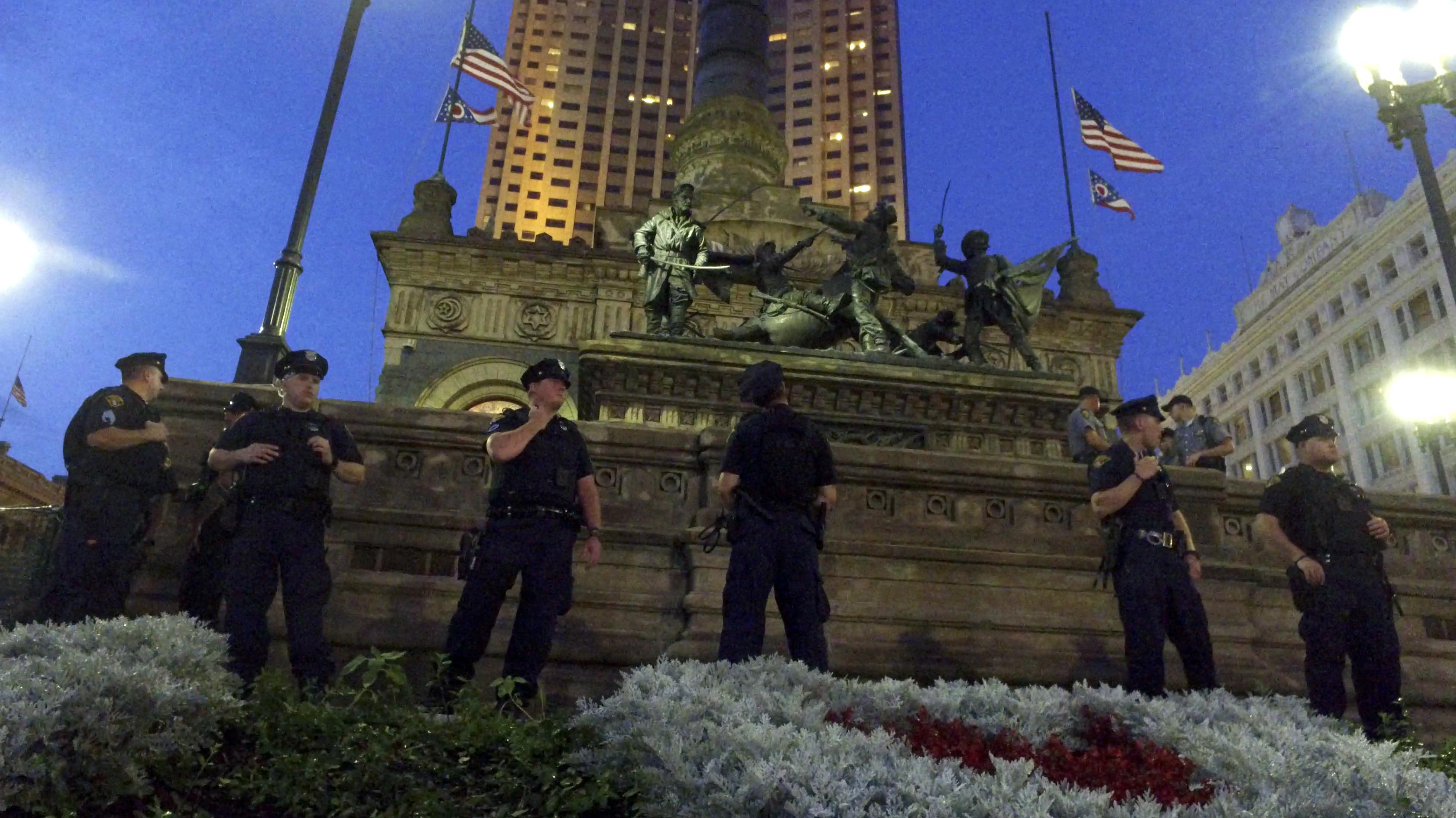 Police watch over the public square during protests on Thursday, July 21, 2016 in Cleveland.