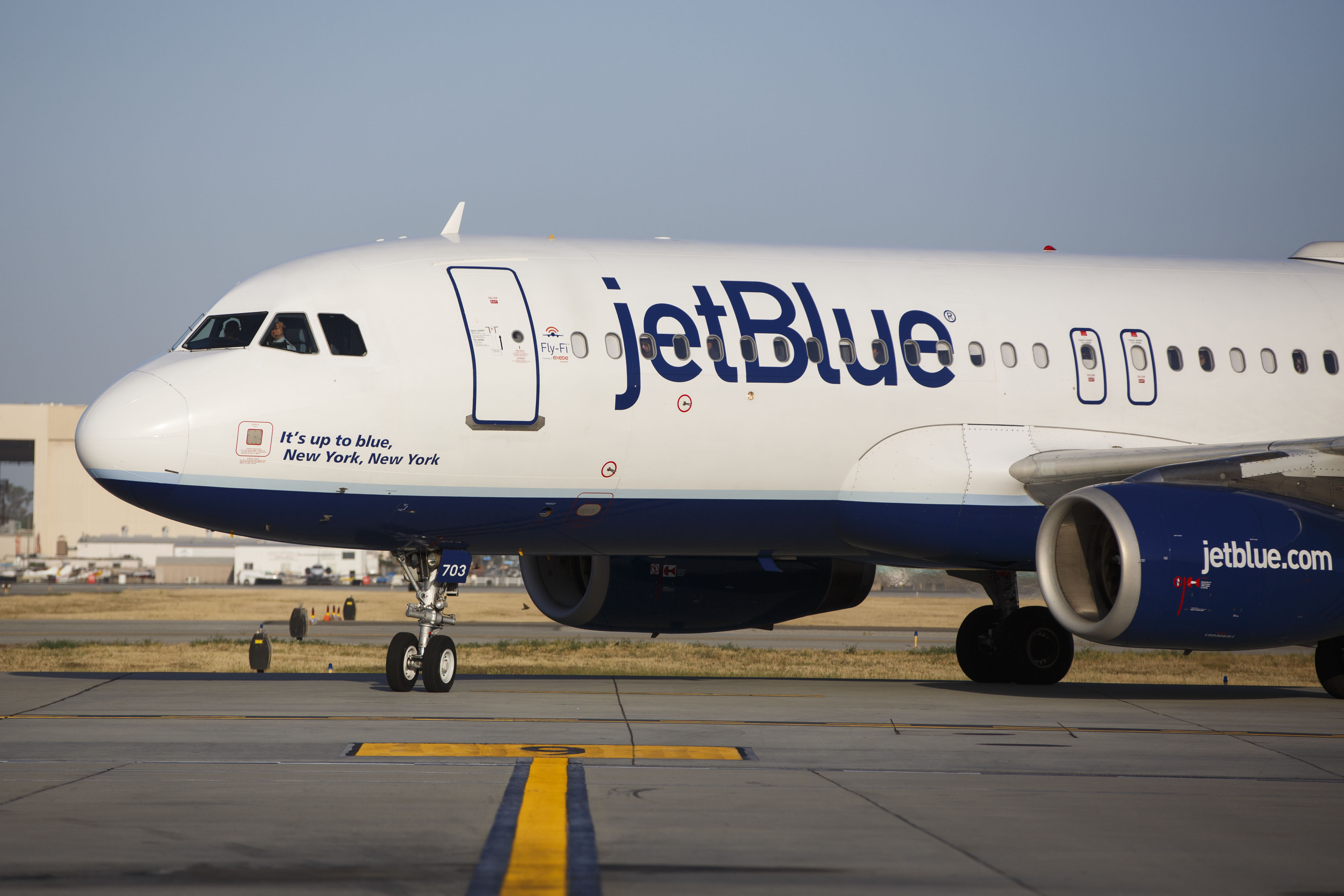 A JetBlue Airways Corp. Airbus Group SE A320 aircraft taxis to the gate on the tarmac at Long Beach Airport in Long Beach, California, on April 25, 2016.