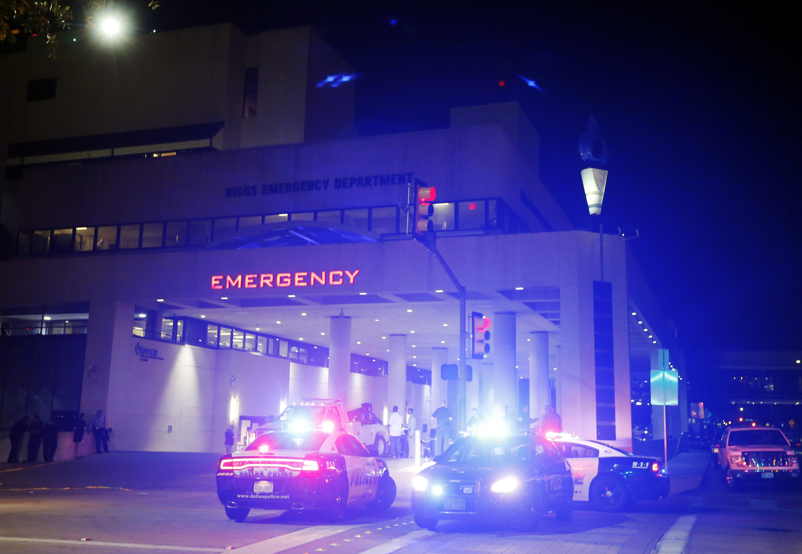 Emergency responder vehicles sit outside of the emergency room at Baylor University Medical Center on July 8, 2016, in Dallas.