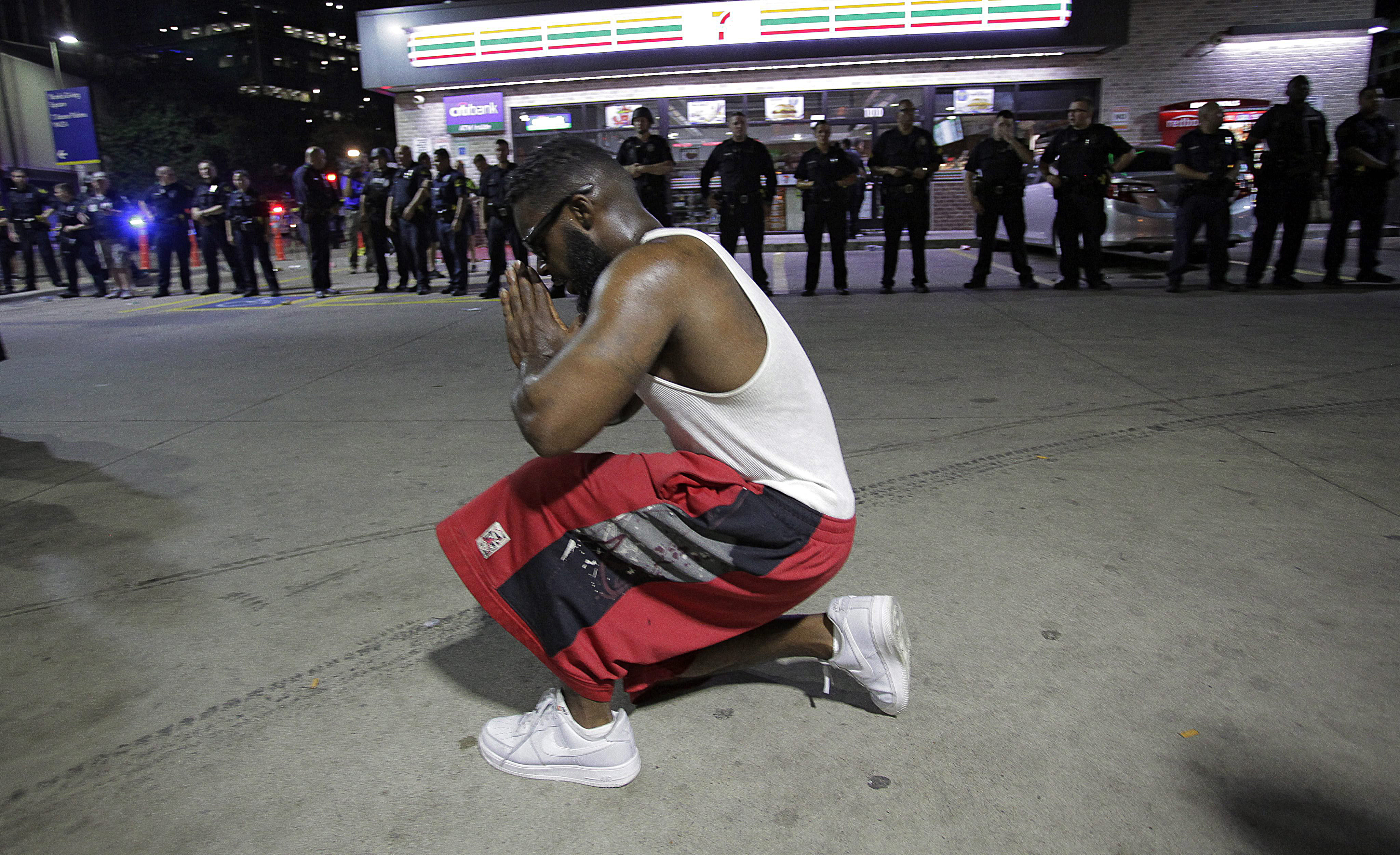 Dallas police officers face protesters on the corner of Ross Ave. and Griffin Street after police officers were shot during a peaceful protest in Dallas,.