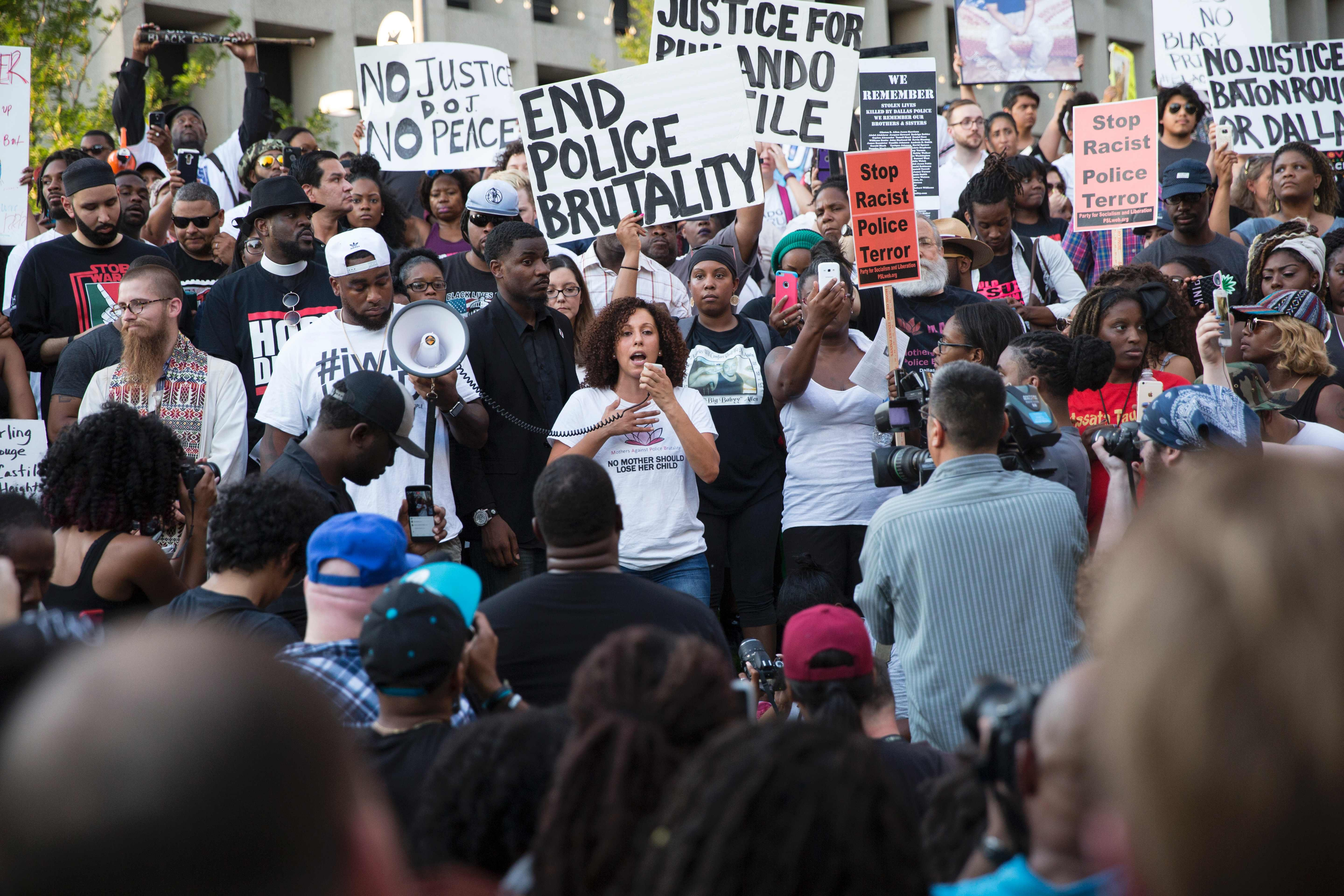 People rally in Dallas on Thursday, July 7, 2016 to protest the deaths of Alton Sterling and Philando Castile.