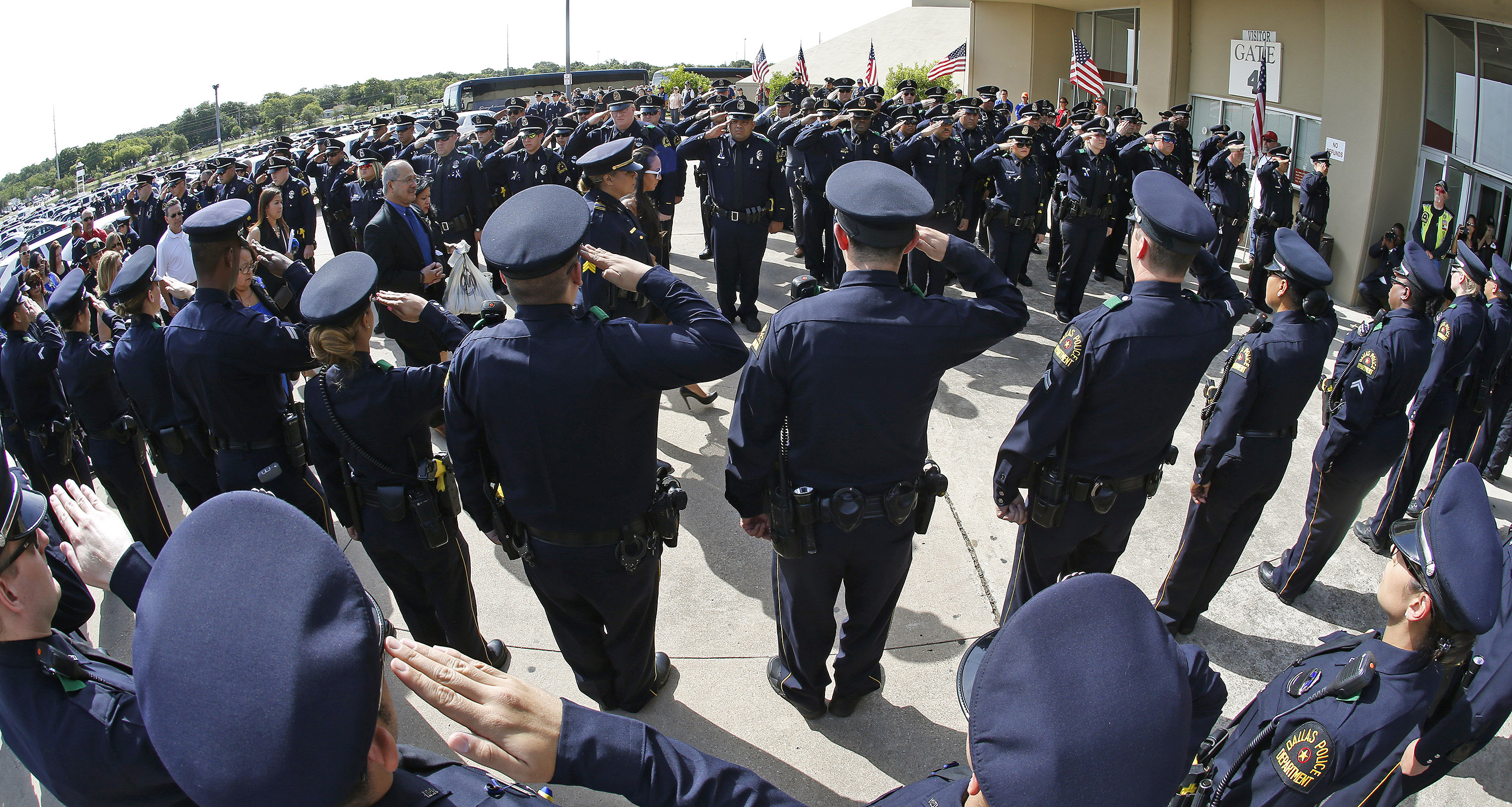 Dallas Police officers salute as family of officer Patrick Zamarippa arrives for his funeral on July 16, 2016. Zamarippa was one of the officers killed during the shooting in Dallas on July 7, 2016. Since, Texas Governor Greg Abbott has proposed that attacking police officers should be classified as a hate crime.