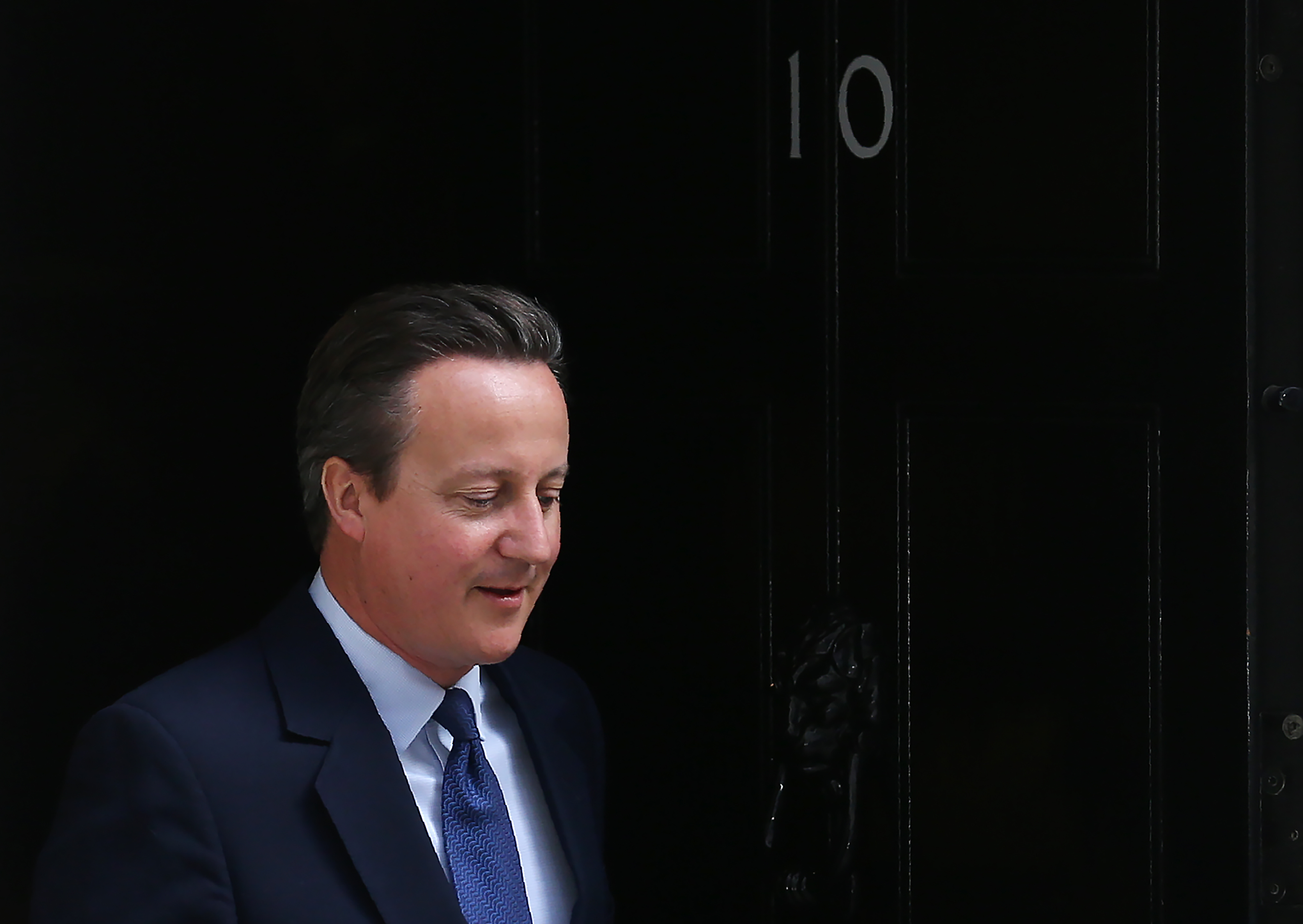 Britain's ougoing Prime Minister David Cameron leaves 10 Downing Street as he prepares to address his final Prime Minister's Question Time in the House of Commons in London on July 13, 2016.