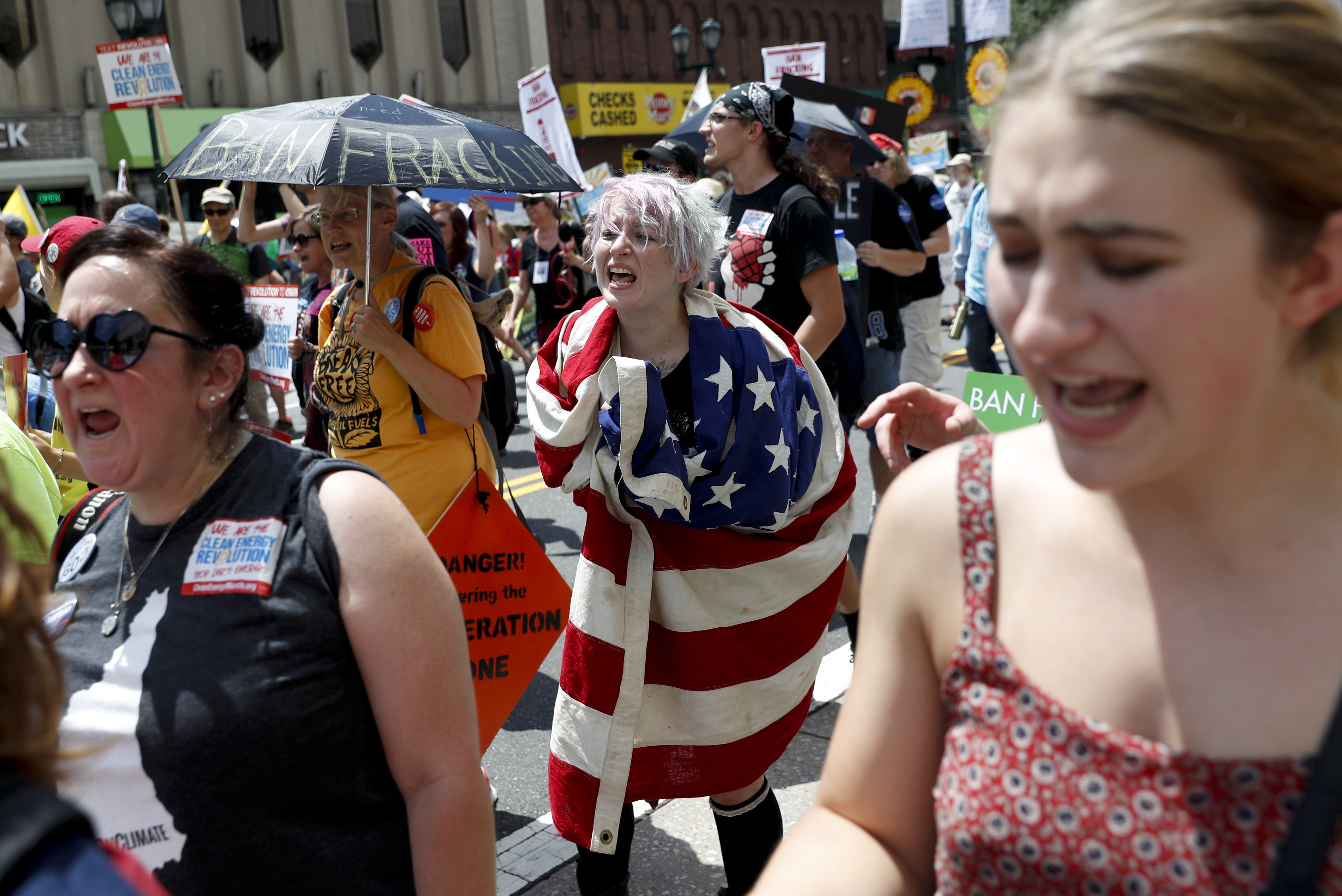 Protesters yell during a demonstration in downtown on Sunday, July 24, 2016, in Philadelphia.