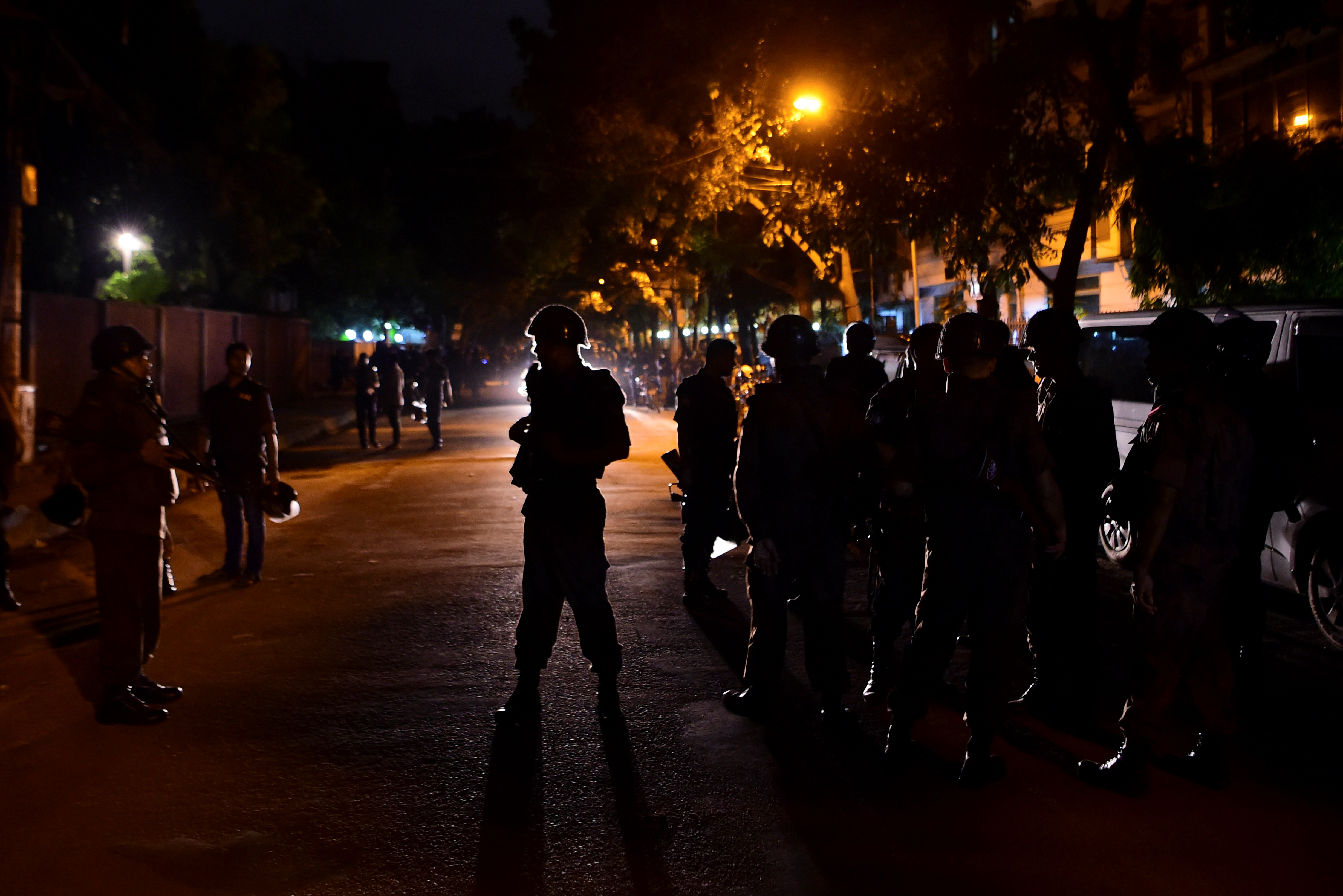 Bangladeshi security personnel stand guard after gunmen stormed a restaurant in Dhaka's high-security diplomatic district early on July 2, 2016.