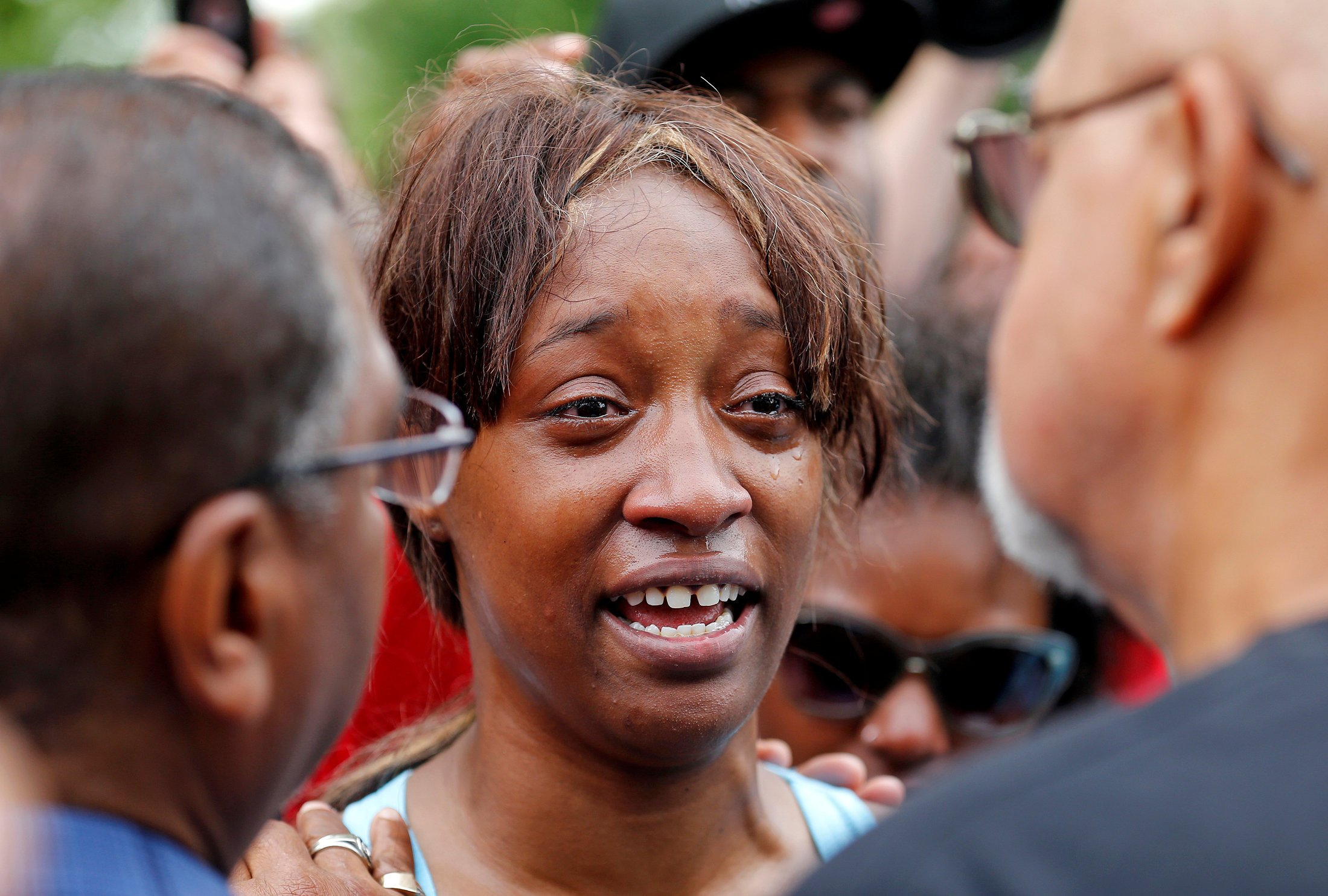 Diamond Reynolds weeps after she recounts the incidents that led to the fatal shooting of her boyfriend Philando Castile by Minneapolis area police during a traffic stop on Wednesday, at a  Black Lives Matter  demonstration in front of the Governor's Mansion in St. Paul, Minn., July 7, 2016.