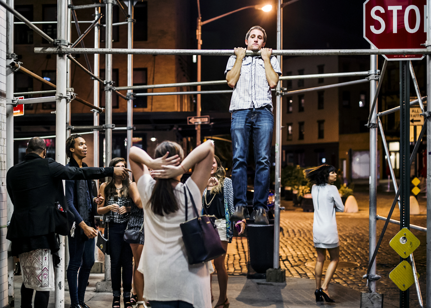 A man does pull-ups on scaffolding in the Meatpacking District in September 2014.