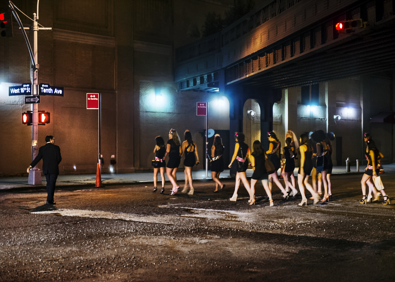 A bachelorette party passes by a man in the Meatpacking District in July 2012.