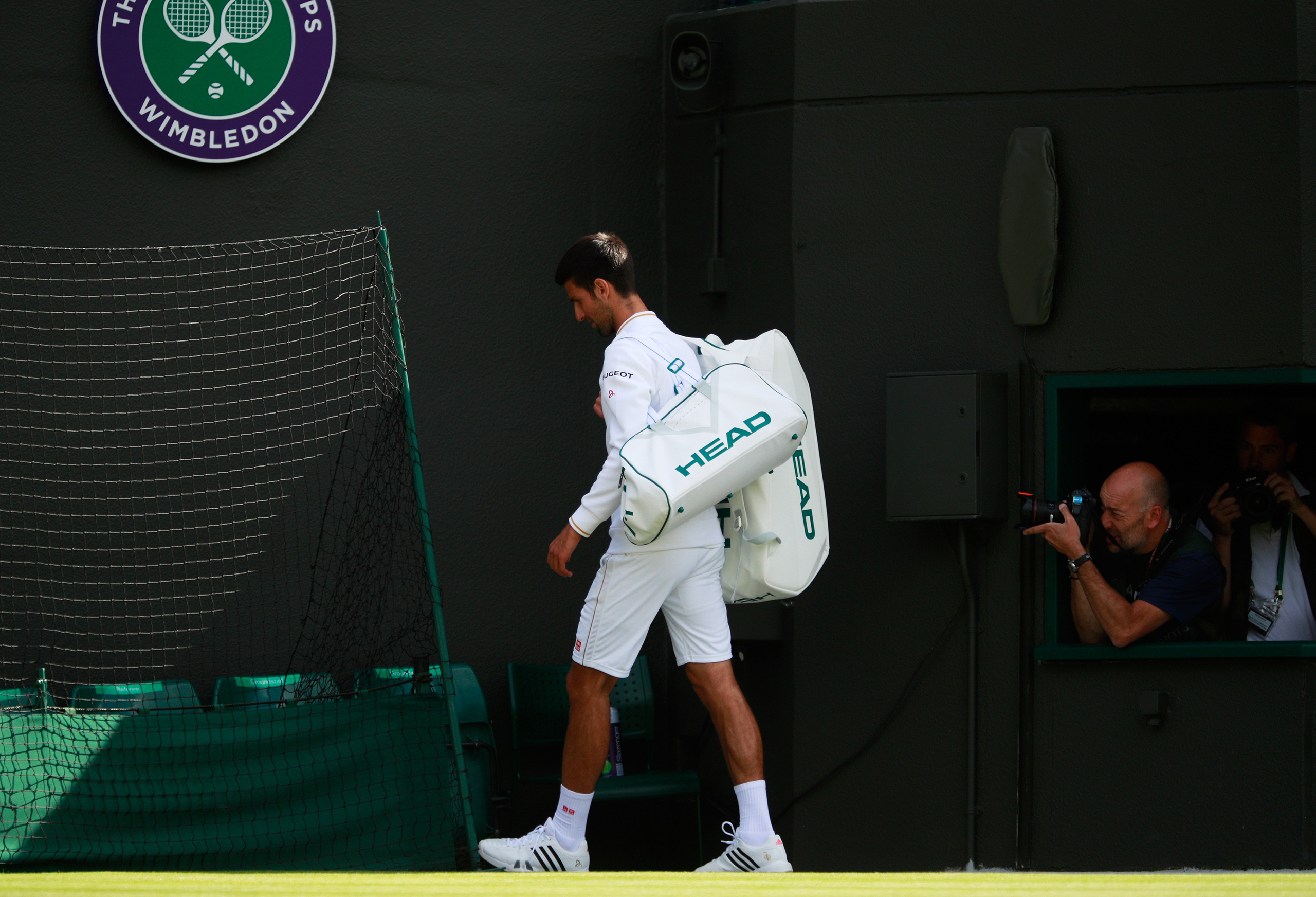 Novak Djokovic of Serbia walks off the court following defeat in the Men's Singles third round match against Sam Querrey of the United States on day six of the Wimbledon Lawn Tennis Championships in London on July 2, 2016.