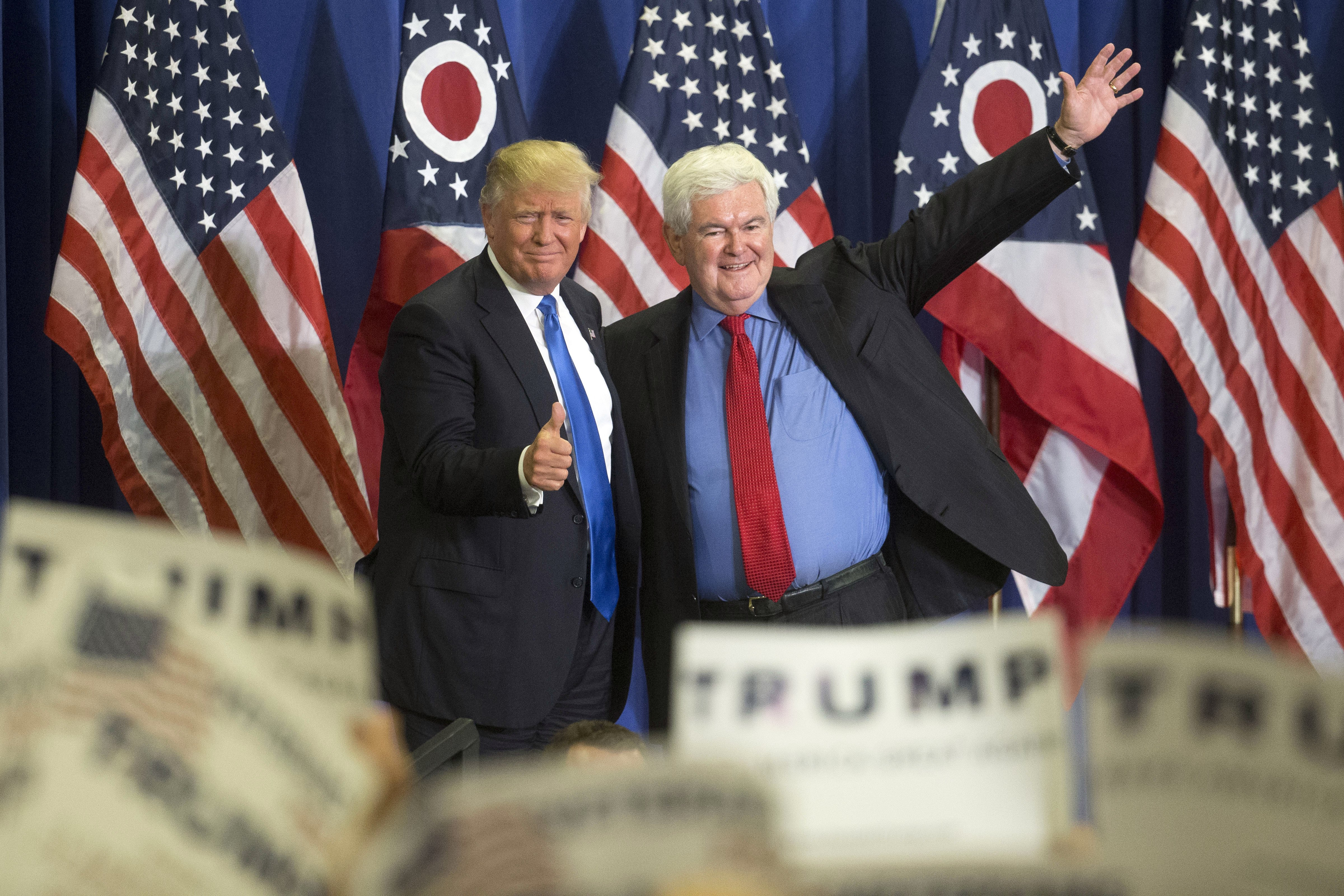 Republican presidential candidate Donald Trump, left, and former House Speaker Newt Gingrich, right, acknowledge the crowd during a campaign rally at the Sharonville Convention Center on July 6, 2016, in Cincinnati.