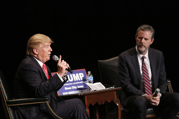 Donald Trump, president and chief executive of Trump Organization Inc. and 2016 Republican presidential candidate, left, speaks as Jerry Falwell Jr., president of Liberty University, listens during a campaign event at the Orpheum Theater in Sioux City, Iowa, U.S., on Sunday, Jan. 31, 2016.