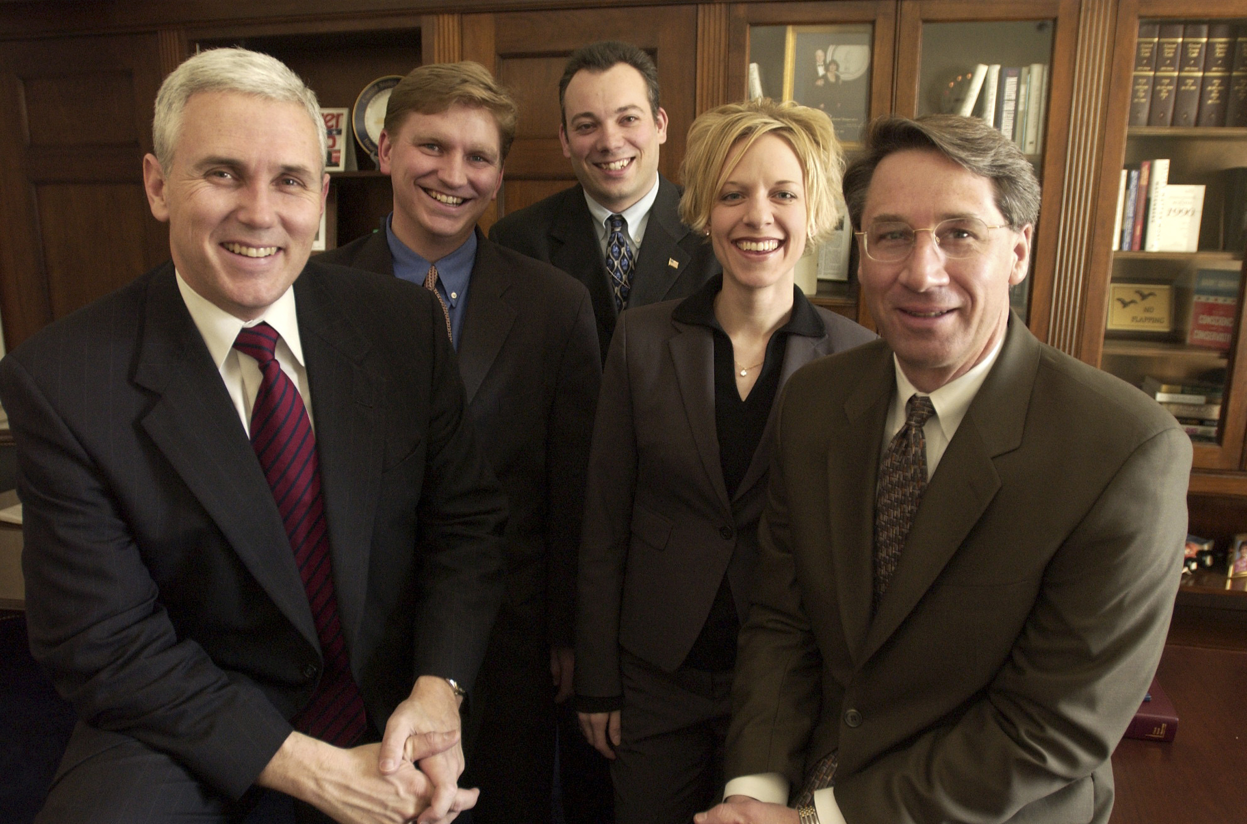 From left, Rep. Mike Pence, R-Ind., Derek Karachner, Ian Slatter, Molly Jurmu, and Mark Ahearn pose for a group portrait on Dec. 12, 2001.