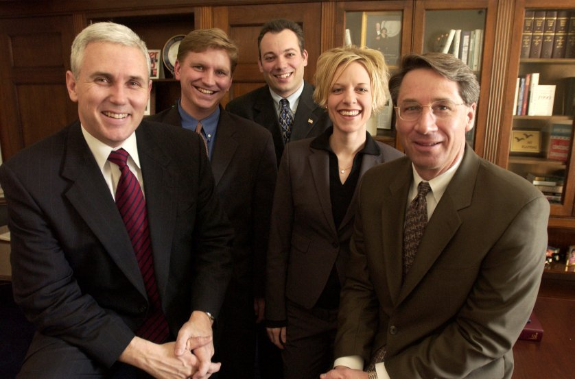 Rep. Mike Pence, R-Ind. (left), Derek Karachner, Ian Slatter, Molly Jurmu, and Mark Ahearn pose for a group portrait on Dec. 12, 2001.