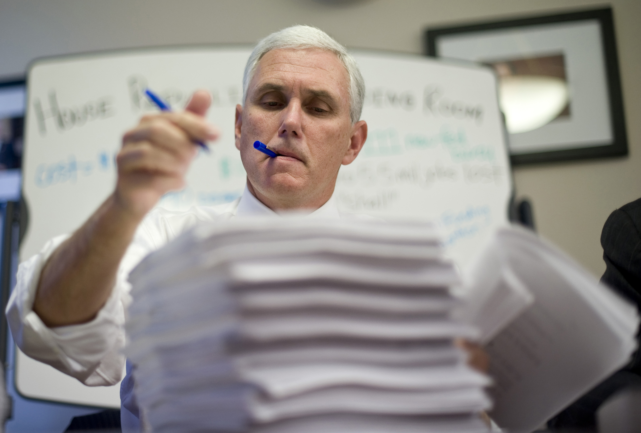 Rep. Mike Pence, R-Ind., makes marks on the House health care bill as House Republicans gathered in the House Republicans Reading Room in the Longworth House Office Building on Nov. 3, 2009.