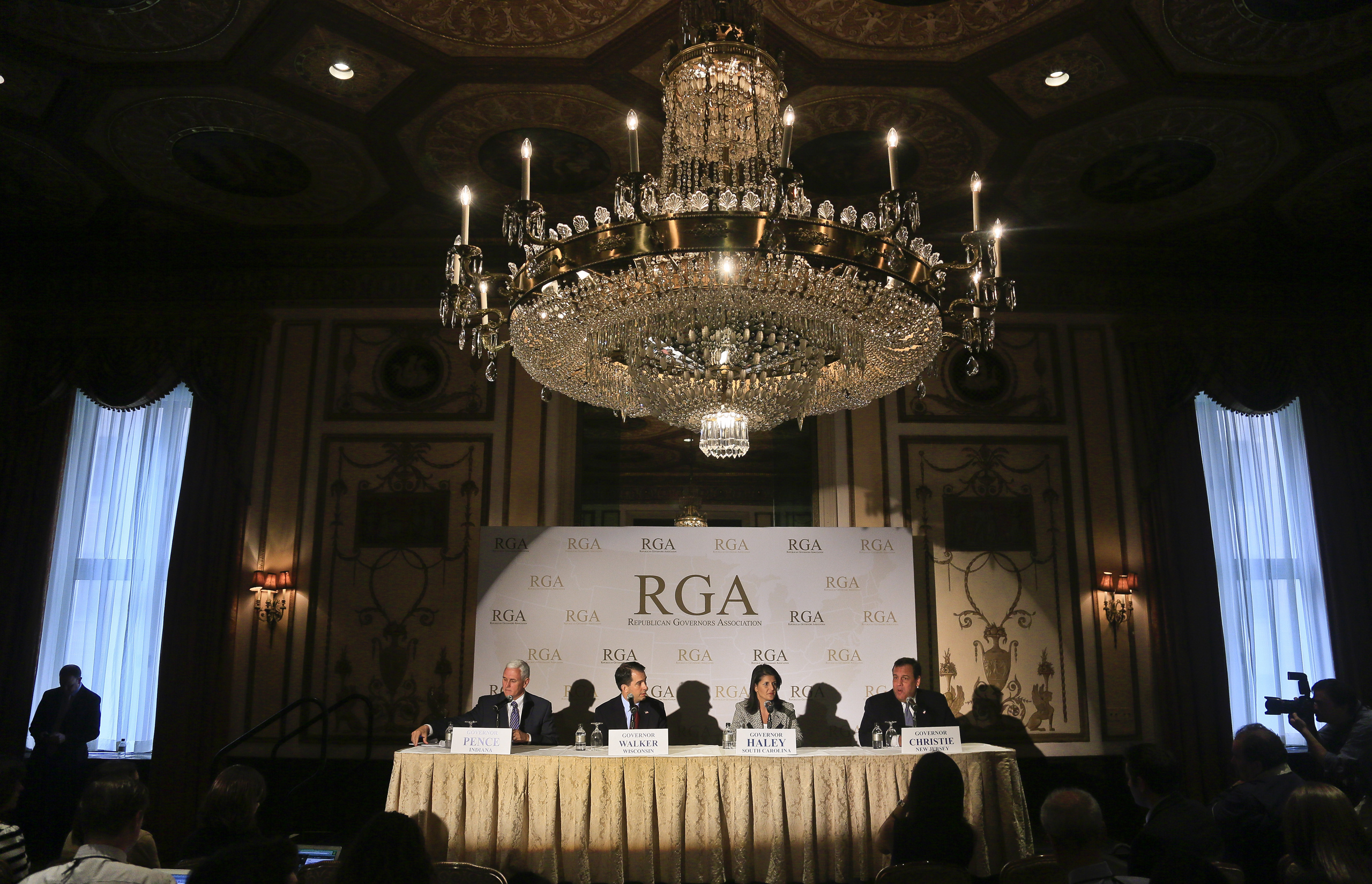 From Left, Ind. Gov. Mike Pence, Wisc. Gov. Scott Walker, S.C. Gov. Nikki R. Haley, and N.J. Gov. Chris Christie sit at the Waldorf Astoria as they prepare to hold a news conference, during the Republican Governors Association's quarterly meeting in New York City on May 21, 2014.