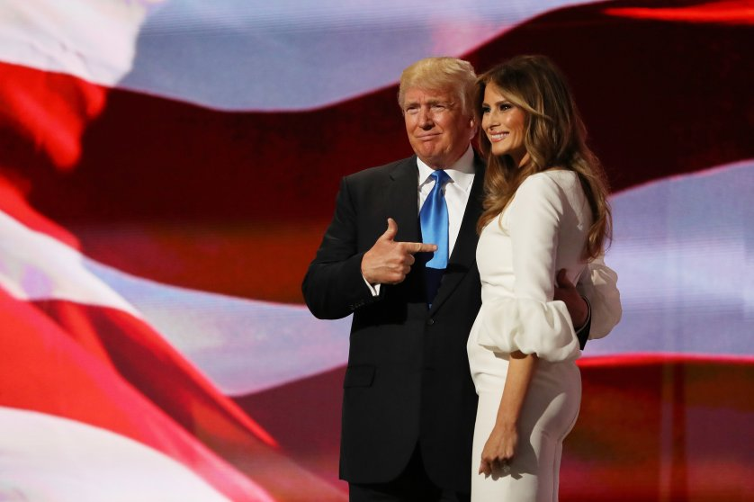Republican presidential nominee Donald Trump gestures to his wife Melania after she delivered a speech on the first day of the Republican National Convention at the Quicken Loans Arena in Cleveland on July 18, 2016.