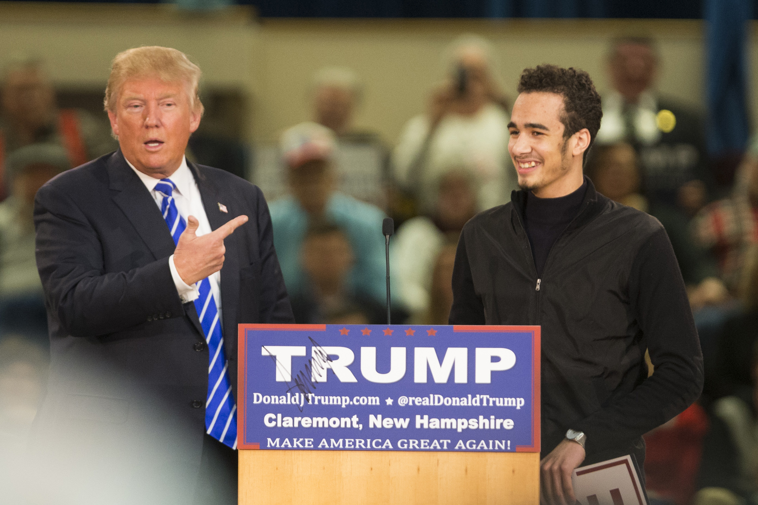 Republican presidential Donald Trump welcomes a supporter on stage at Stevens High School  in Claremont, N.H. on Jan. 5, 2016.