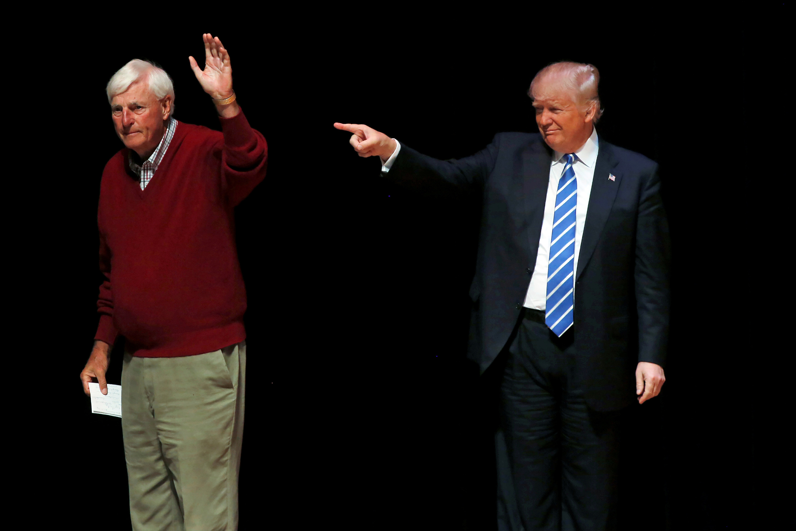 Republican presidential candidate Donald Trump is joined on stage by former Indiana University basketball coach Bob Knight at a campaign event at the Old National Events Plaza in Evansville, Ind. on April 28, 2016.