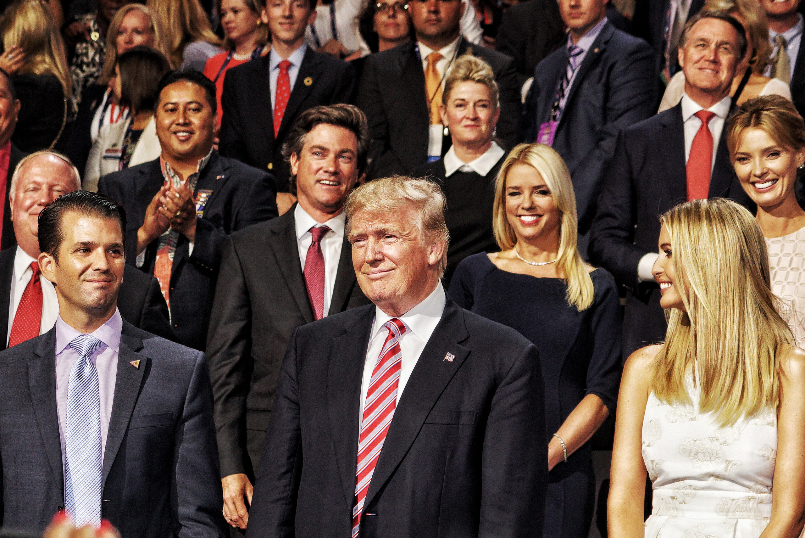 Republican presidential candidate Donald Trump and his family listen to speeches on July 20, 2016, at the Quicken Loans Arena in Cleveland, Ohio.