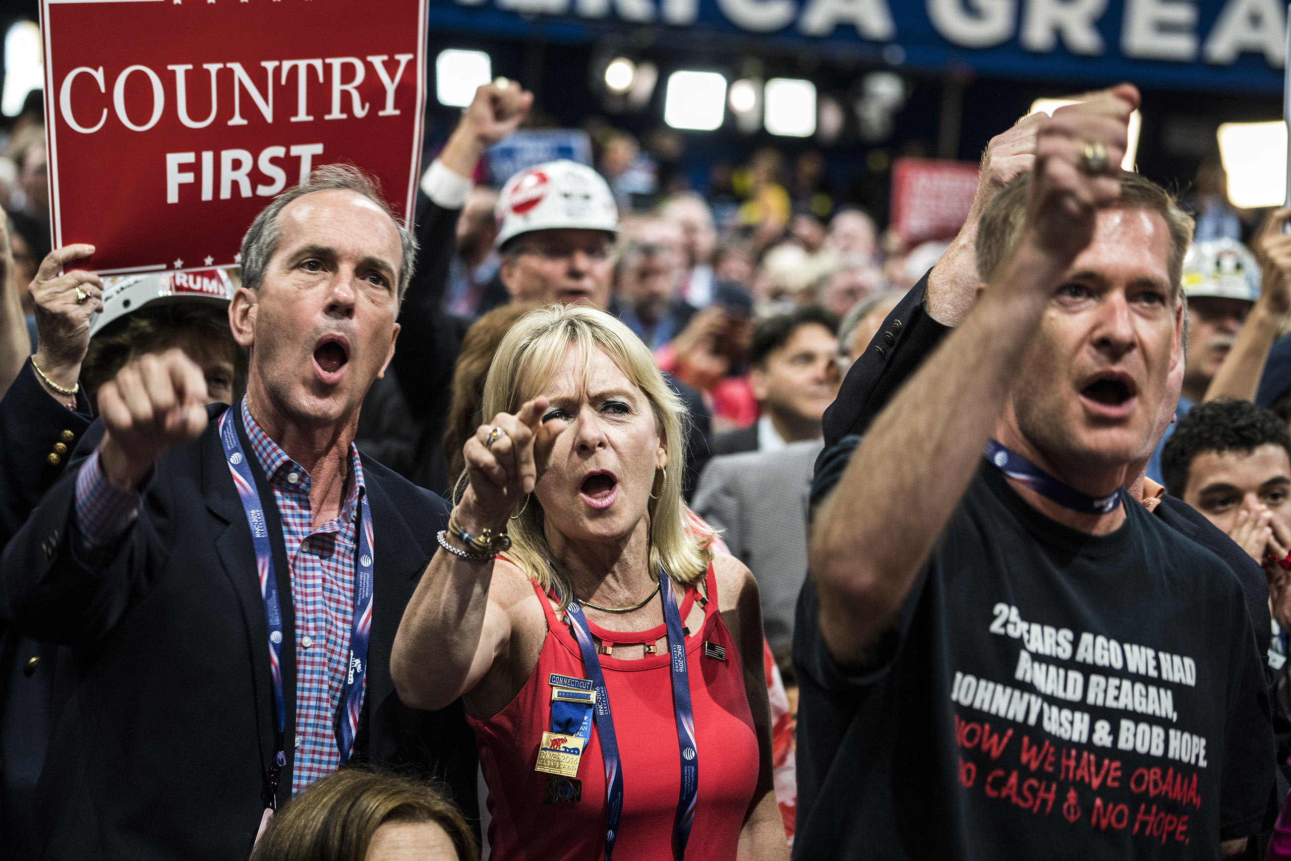 Delegates react to Ted Cruz during his contoversial speech where he refused to endorse presidential candidate Donald Trump on July 20, 2016, at the Quicken Loans Arena in Cleveland, Ohio.
