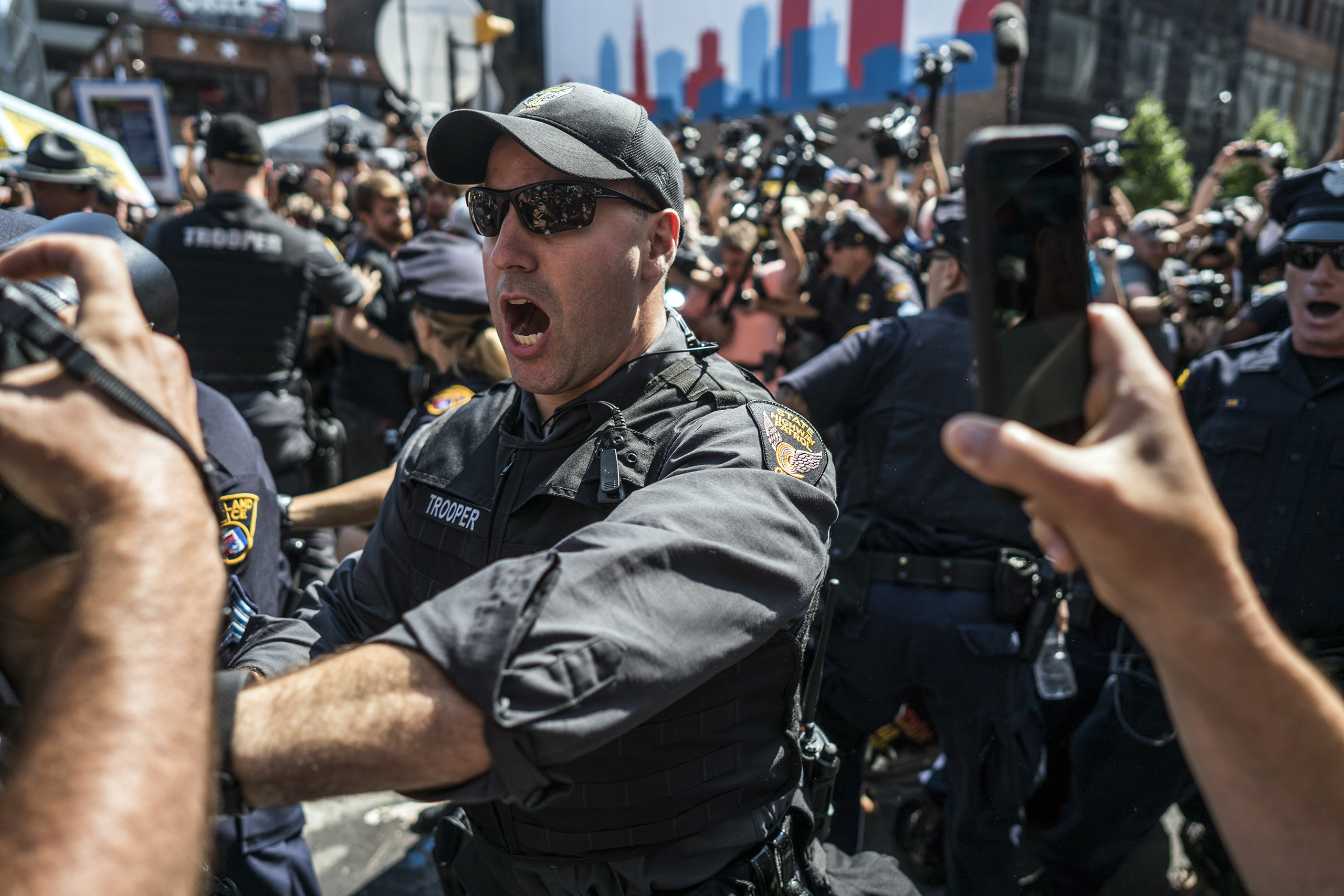 Protesters struggle with law enforcement after trying to burn an American Flag near the sight of the Republican National Convention in downtown Cleveland on the third day of the convention on July 20, 2016 in Cleveland, Ohio.