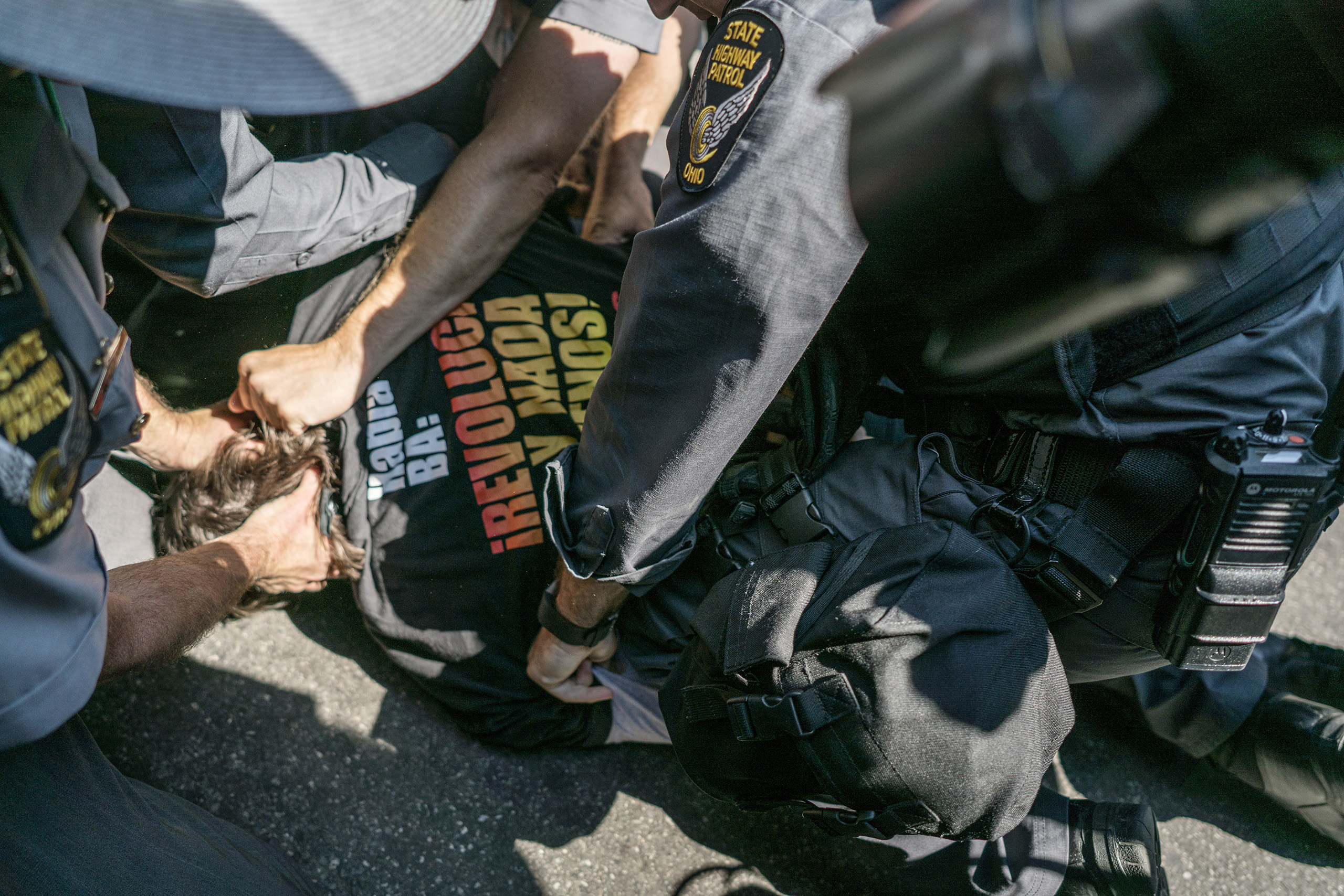 A protestor is restrained by police after a group tried to burn an American Flag near the sight of the Republican National Convention in downtown Cleveland July 20, 2016 in Cleveland, Ohio.