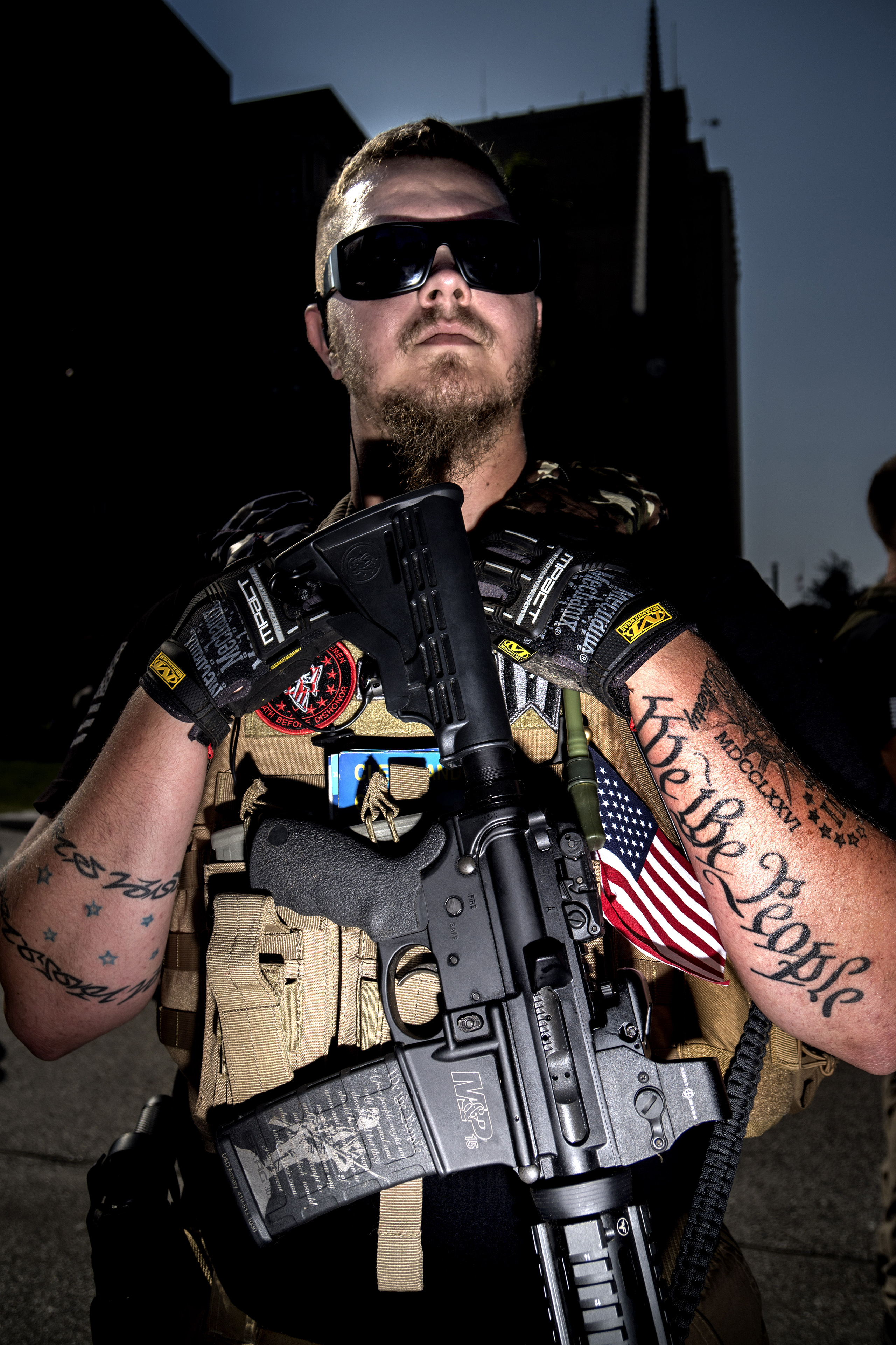 Trevor Leis, of Lime OH, supports open carry and the ammo clip of his AR-15 is laser engraved with the constitution. Leis showed up at the Cleveland public square to demonstrate along with hundreds of other protesters representing numerous agendas and beliefs on July 19, 2016.