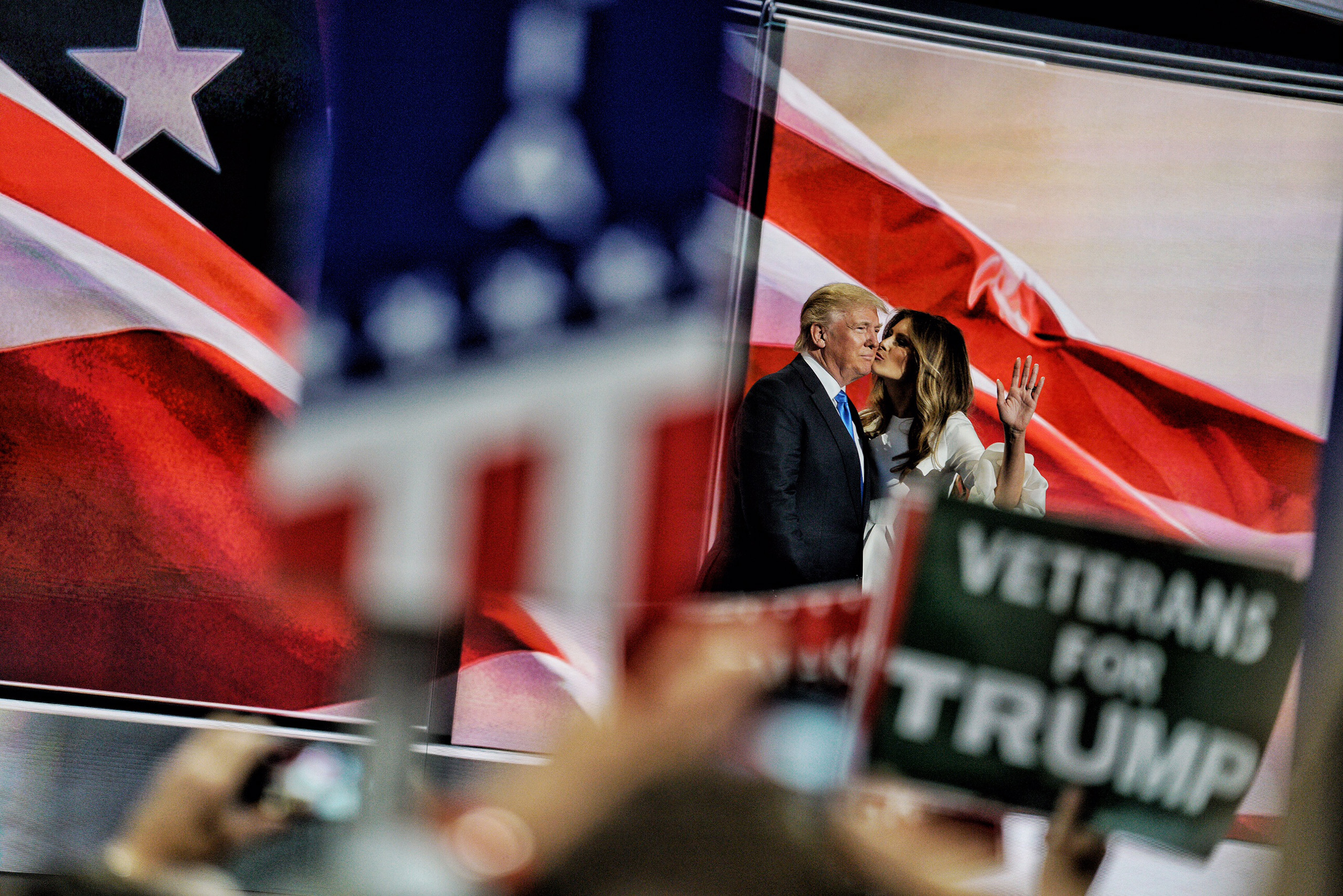 Donald Trump, left, kisses his wife Melania during the Republican National Convention in Cleveland, Ohio, on Monday, July 18, 2016.