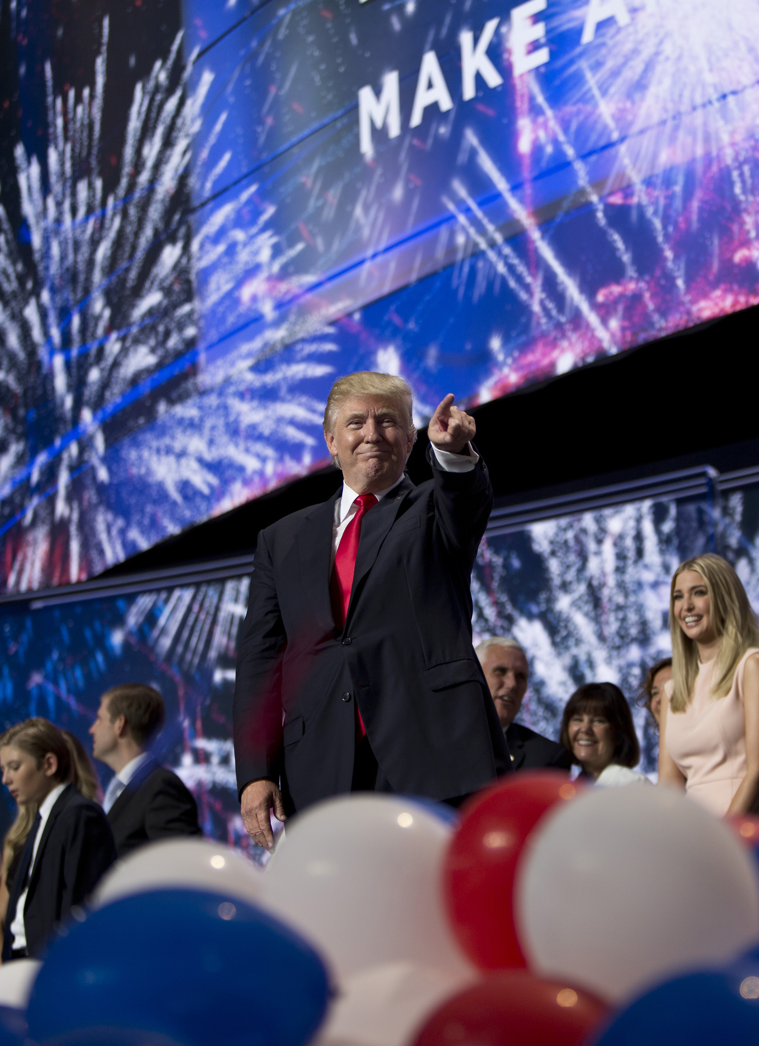 Republican presidential candidate Donald Trump and Republican vice presidential candidate Mike Pence stand with their families at the end of the Republican National Convention on July 21, 2016 at the Quicken Loans Arena in Cleveland.