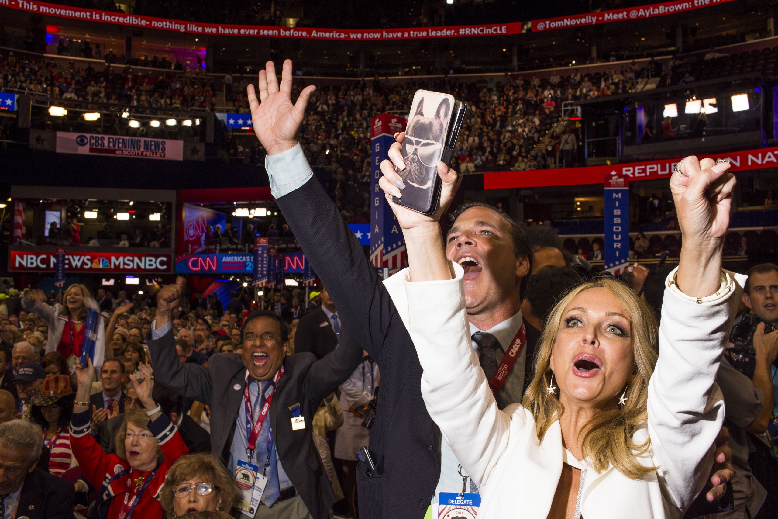 Delegates react to a speech at the Republican National Convention, July 19, 2016 in Cleveland.