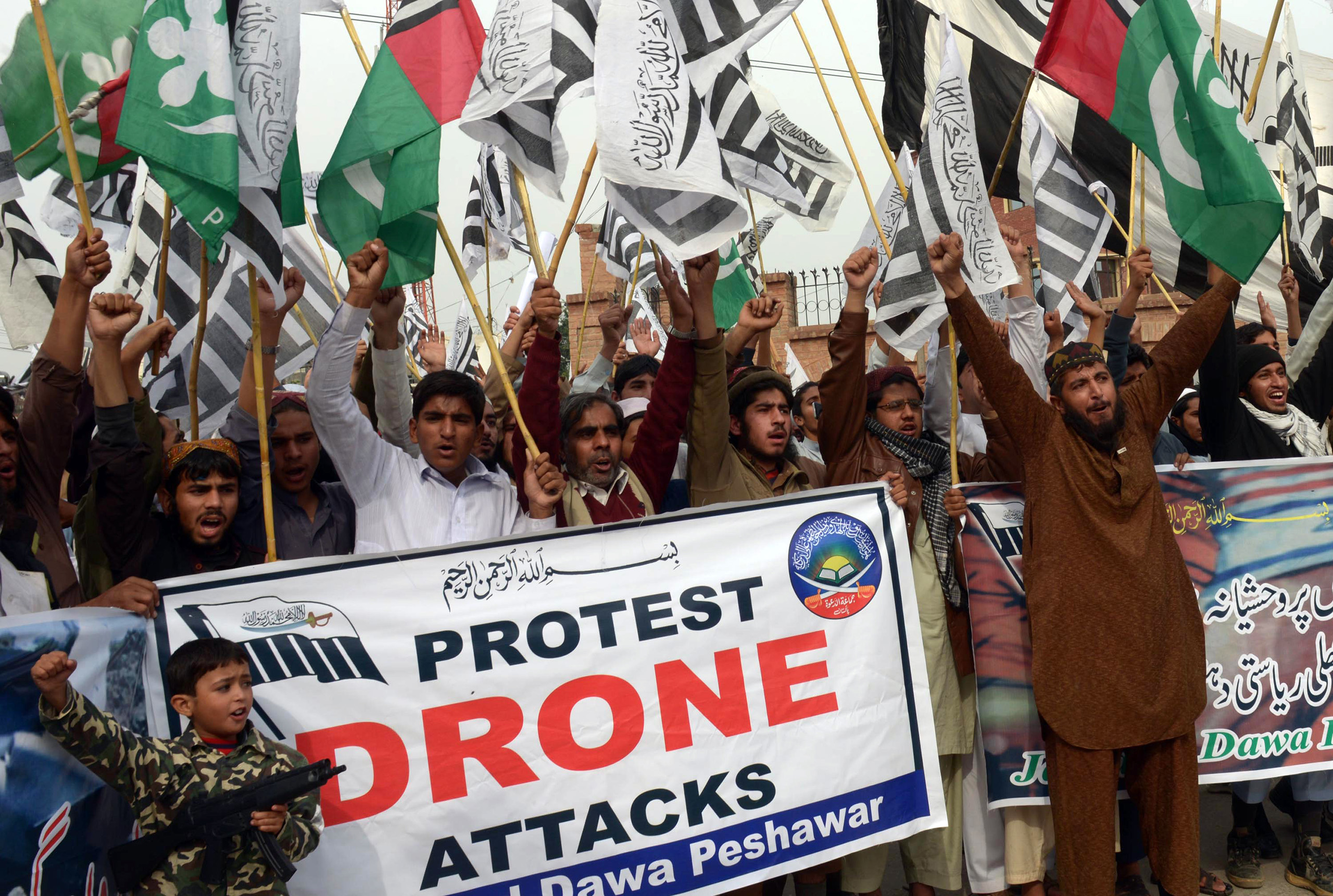 Supporters of Defense of Pakistan Council (DPC), a coalition of religious and political parties, protest against the US drone strikes in the Pakistani tribal region, in Peshawar on Nov. 10, 2013.