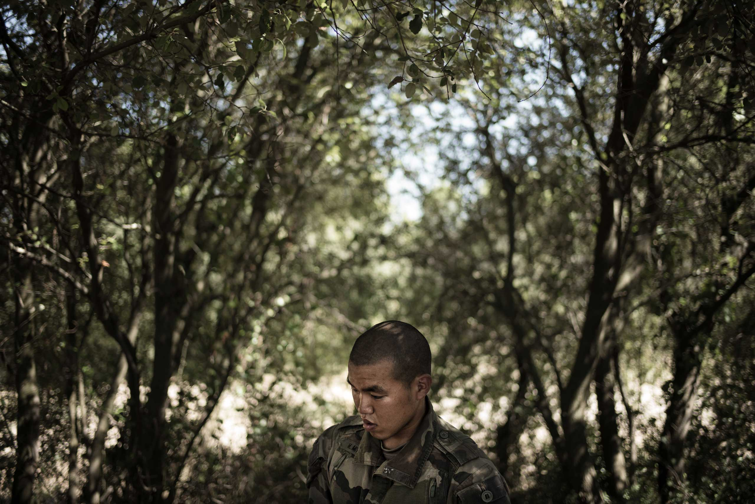 A Japanese Legionnaire is waiting for instructions during his training. Nimes, France. Aug. 11, 2015.