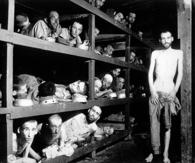 Inmates of the Buchenwald camp inside their barrack, a few days after U.S. troops liberated this concentration camp near Weimar, Germany, on April 16, 1945. The young man seventh from left in the middle row bunk is Elie Wiesel.