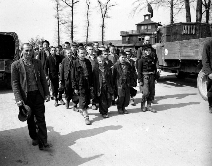 Children and other prisoners liberated by the 3rd U.S. Army march from Buchenwald concentration camp near Weimar, Germany, in April 1945. The freed prisoners are walking to an American hospital to receive treatment. The tall youth in the line at left, fourth from the front, is Elie Wiesel.