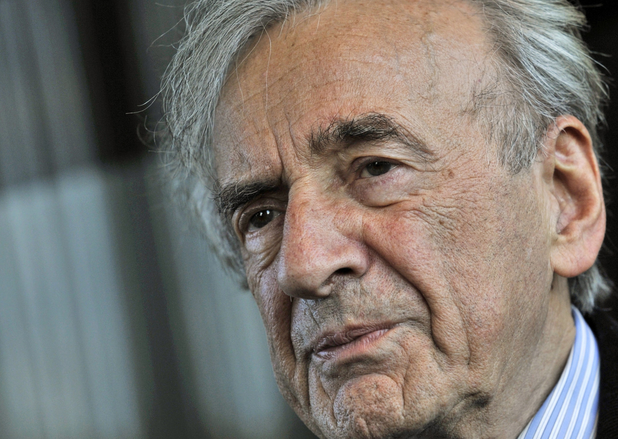 Holocaust survivor and Nobel Peace Prize winning author Elie Wiesel listens during an interview with The Associated Press in Budapest, Hungary, Dec. 10, 2009.