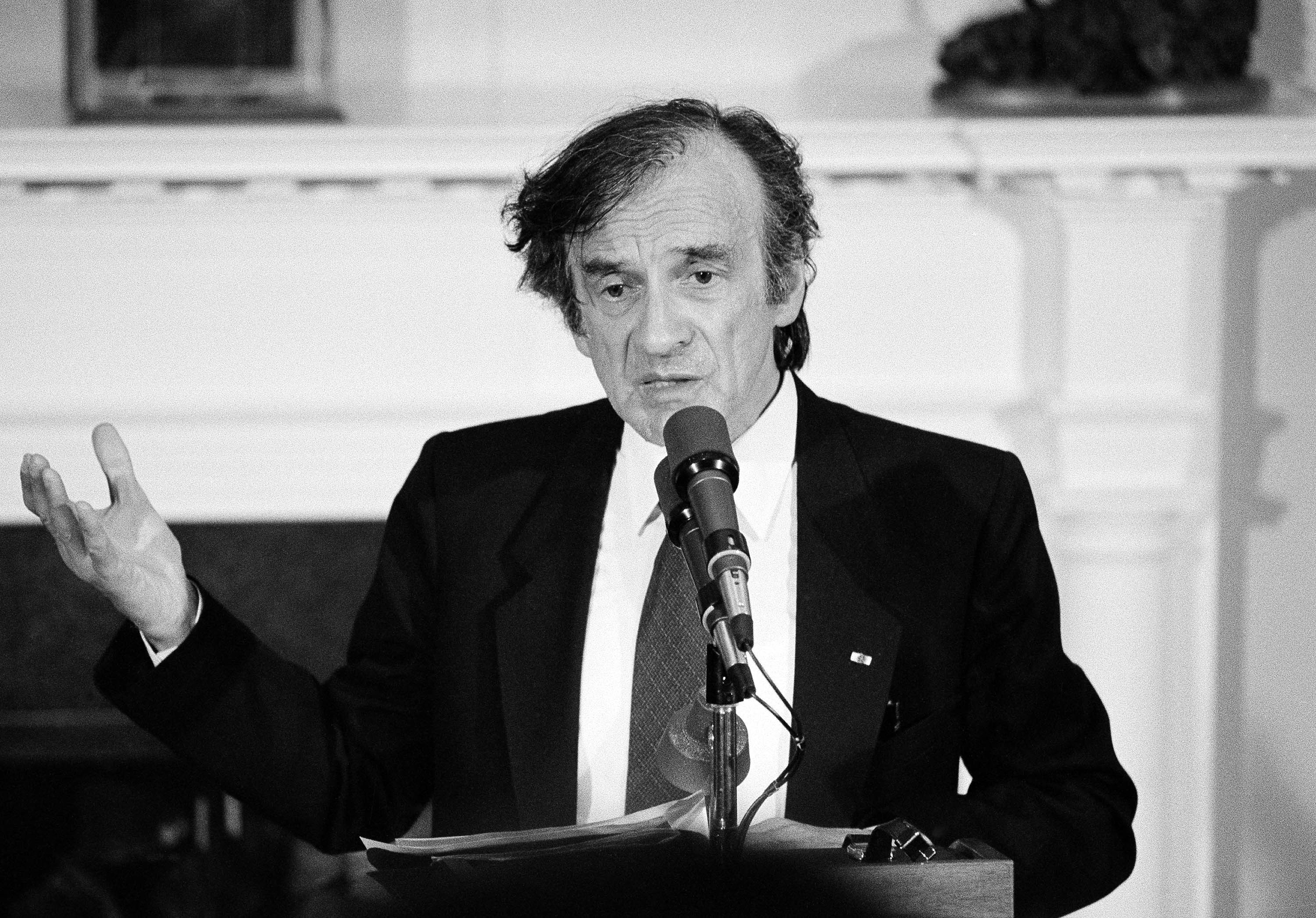 Holocaust survivor Elie Wiesel gestures while talking during a White House ceremony when President Ronald Reagan presented him with the Congressional Gold Medal on April 20, 1985.