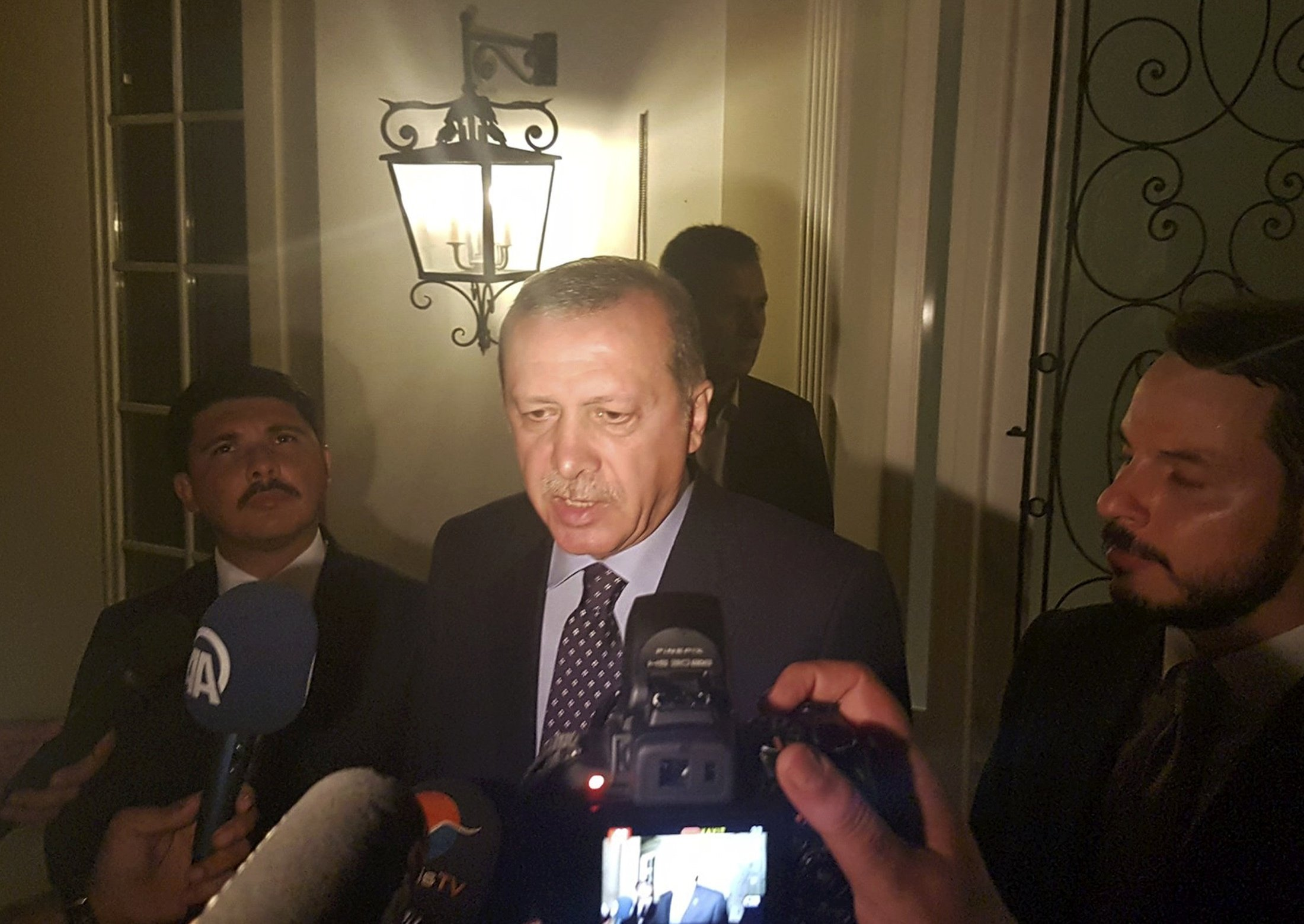 Turkish President Recep Tayyip Erdogan speaks to media in the resort town of Marmaris, Turkey, on July 15, 2016.