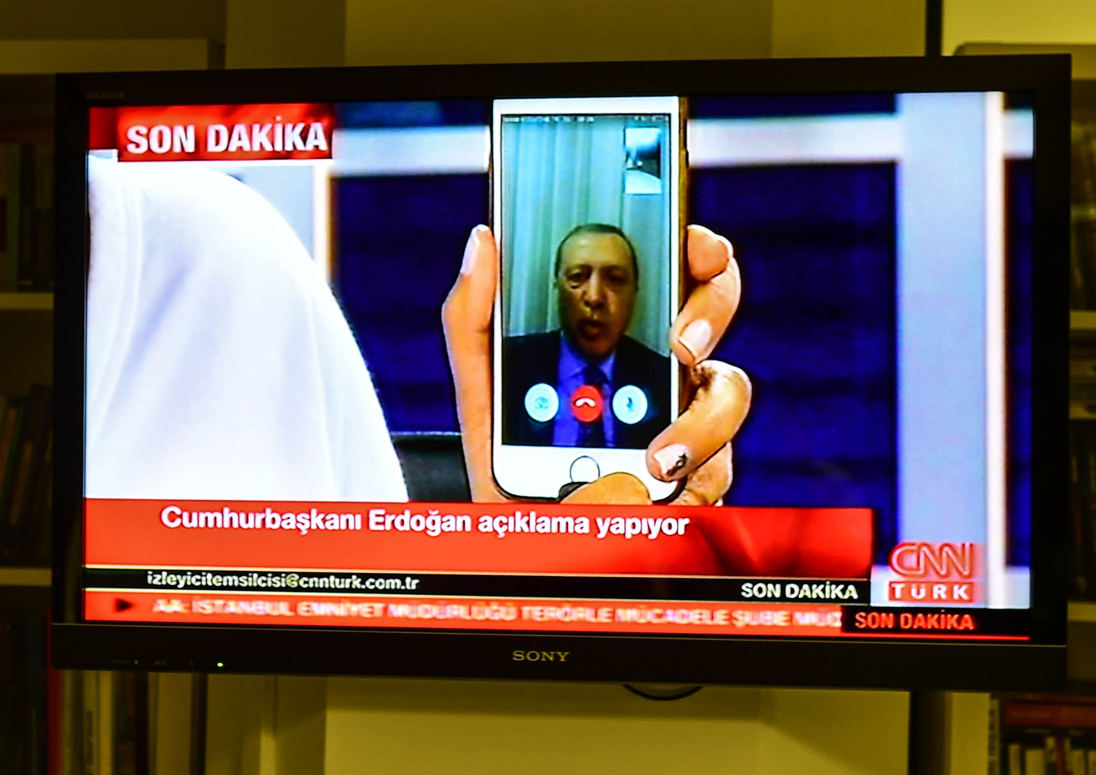 Turkish President Recep Tayyip Erdogan speaks on CnnTurk via facetime call on July 15, 2016, in Istanbul.