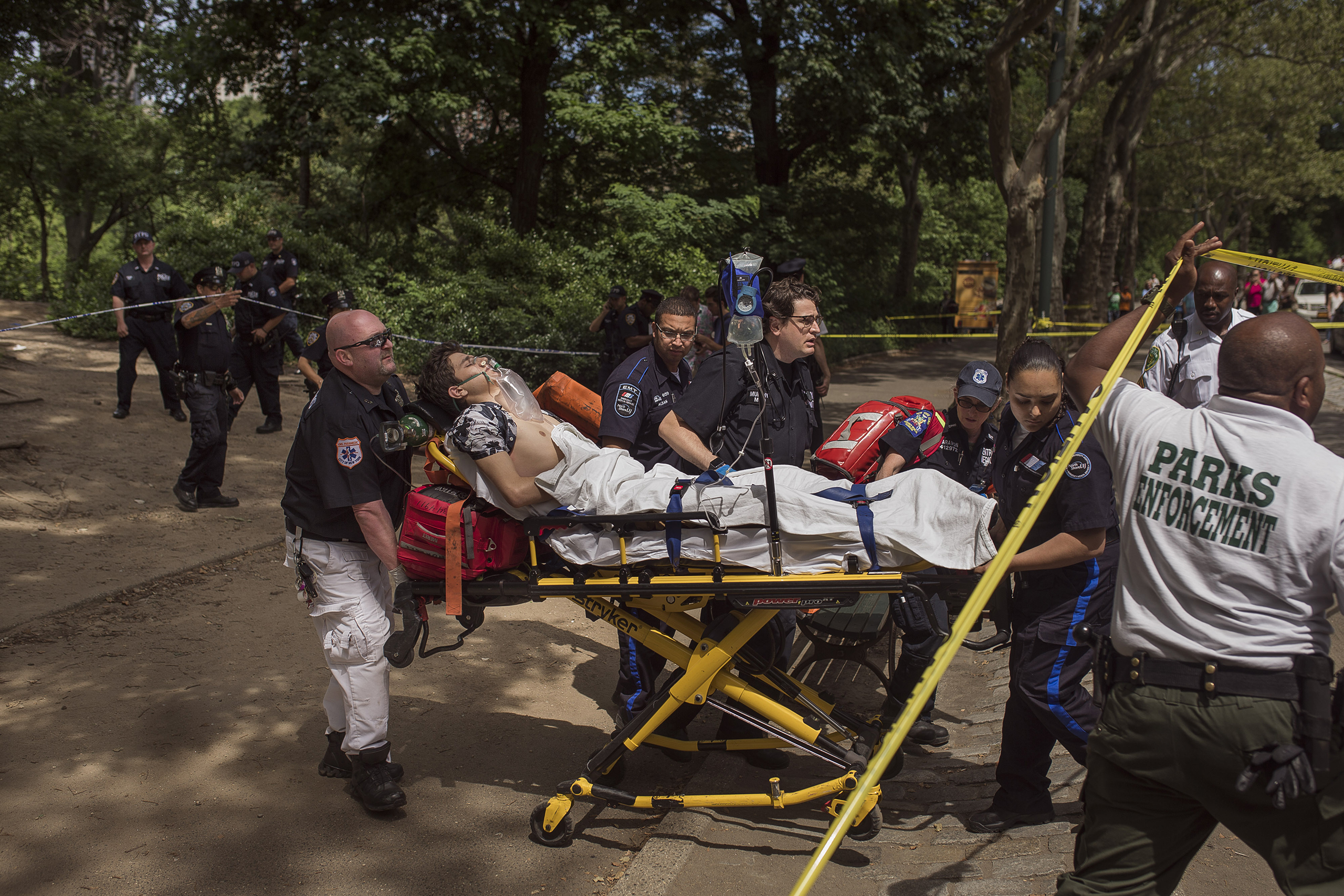 A injured man is carried to an ambulance in Central Park in New York City on July 3, 2016.