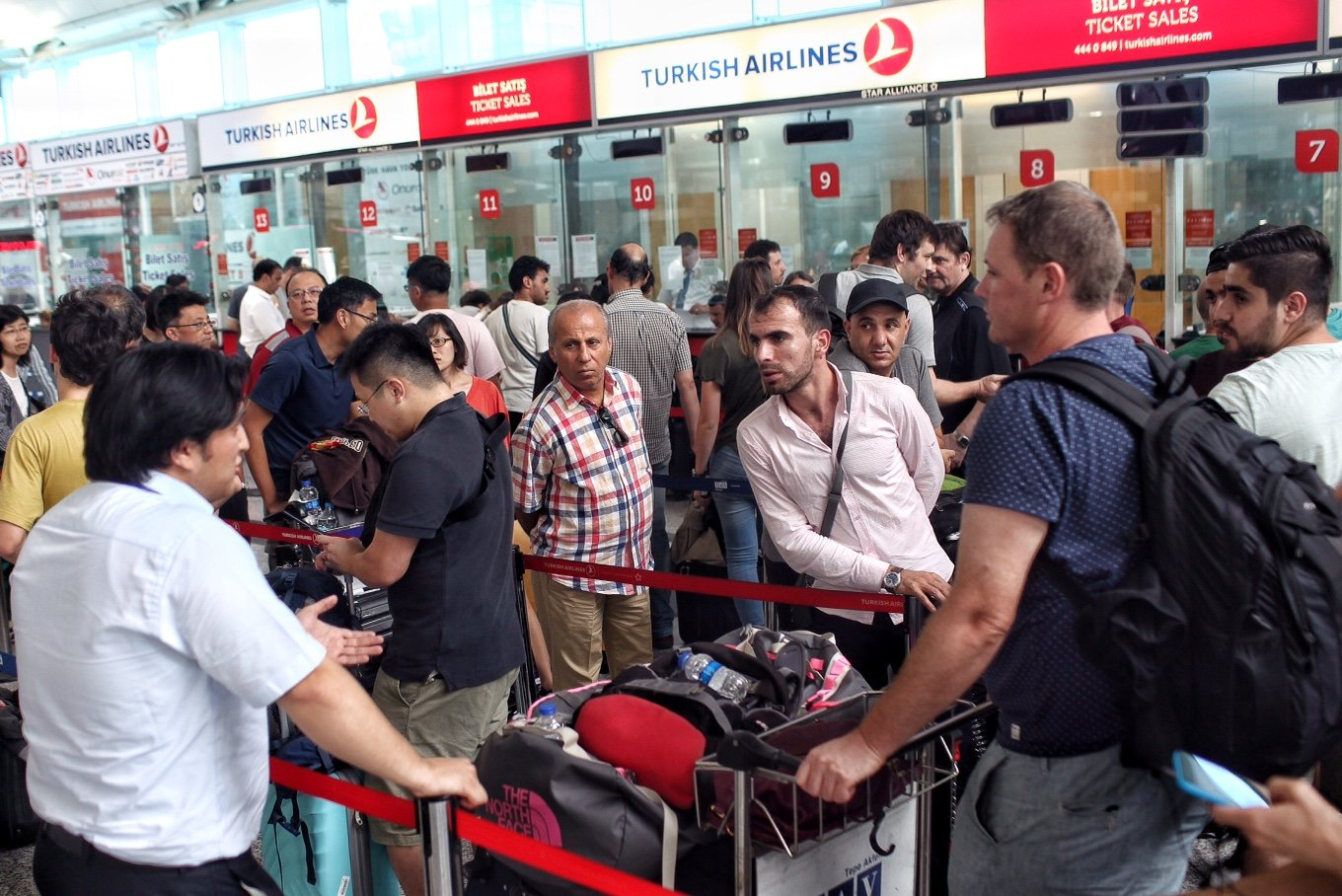 International passengers wait for flight information after flights to Ataturk Airport were delayed or cancelled on July 17, 2016 in Istanbul.